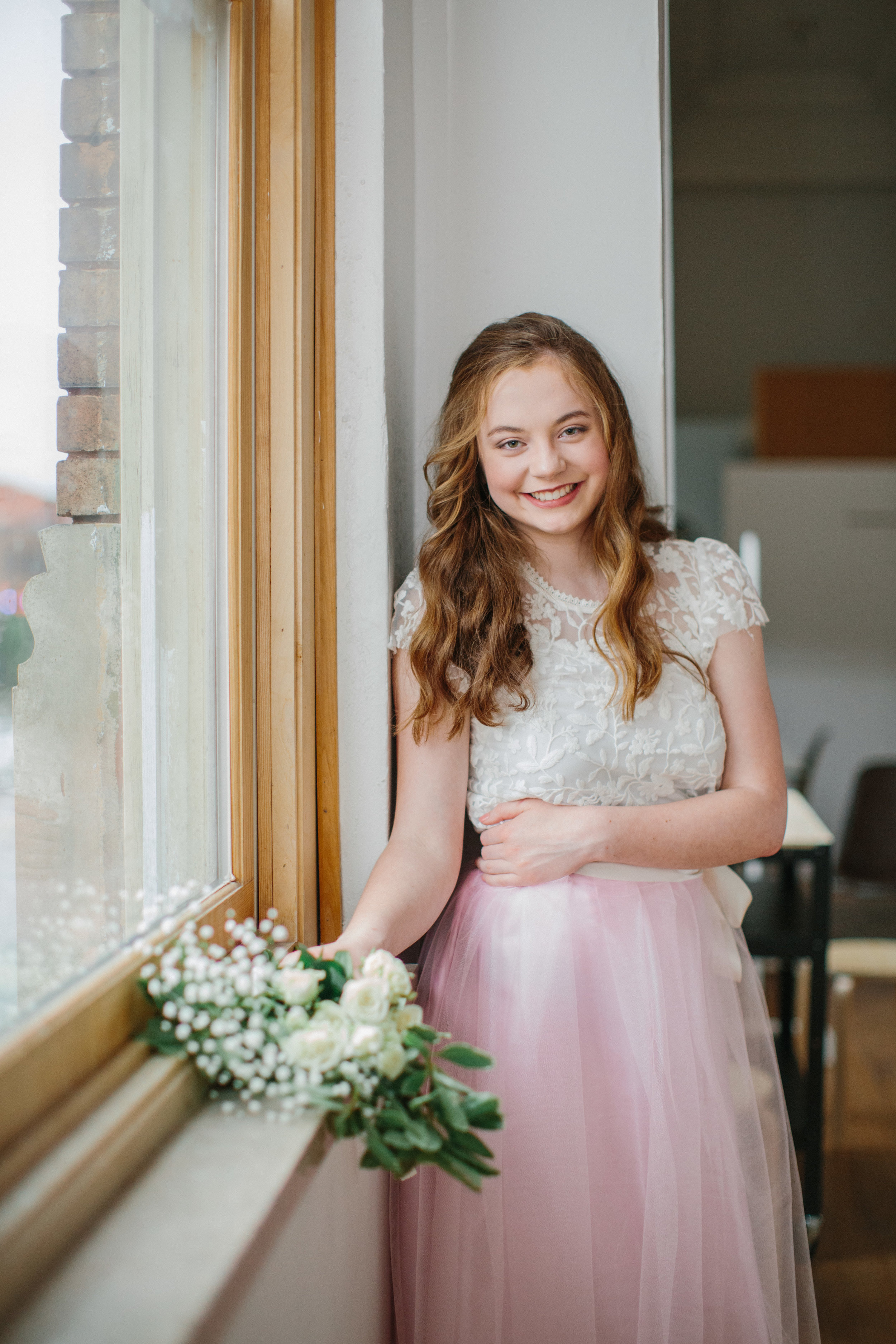 fairytale princess inspired senior photos with long pink skirt and flowers