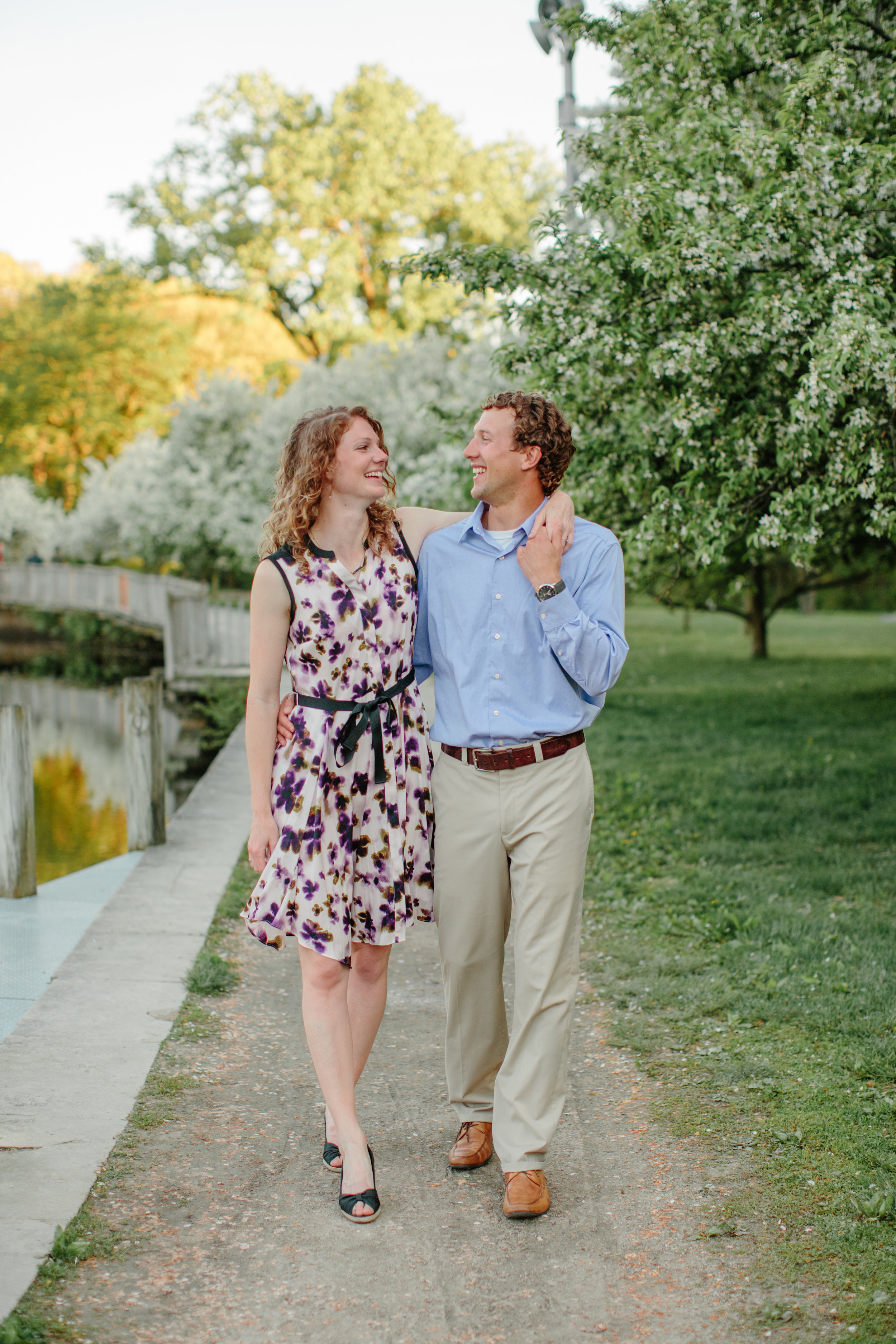 couple walking arm in arm engagement pictures