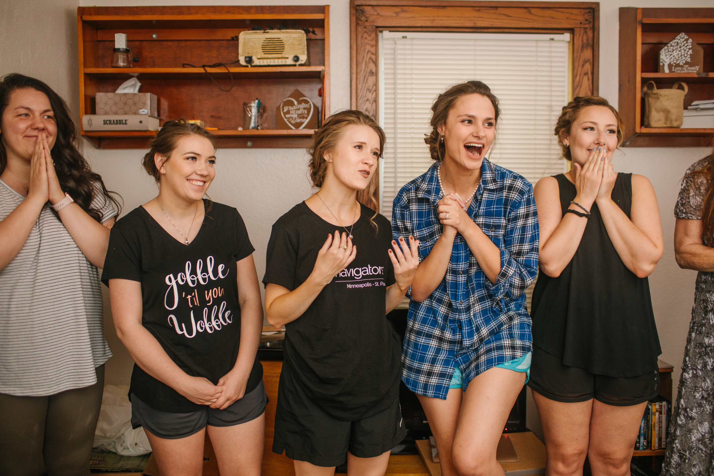 bridesmaids react to seeing friend bride . morganne for the first time des moines iowa