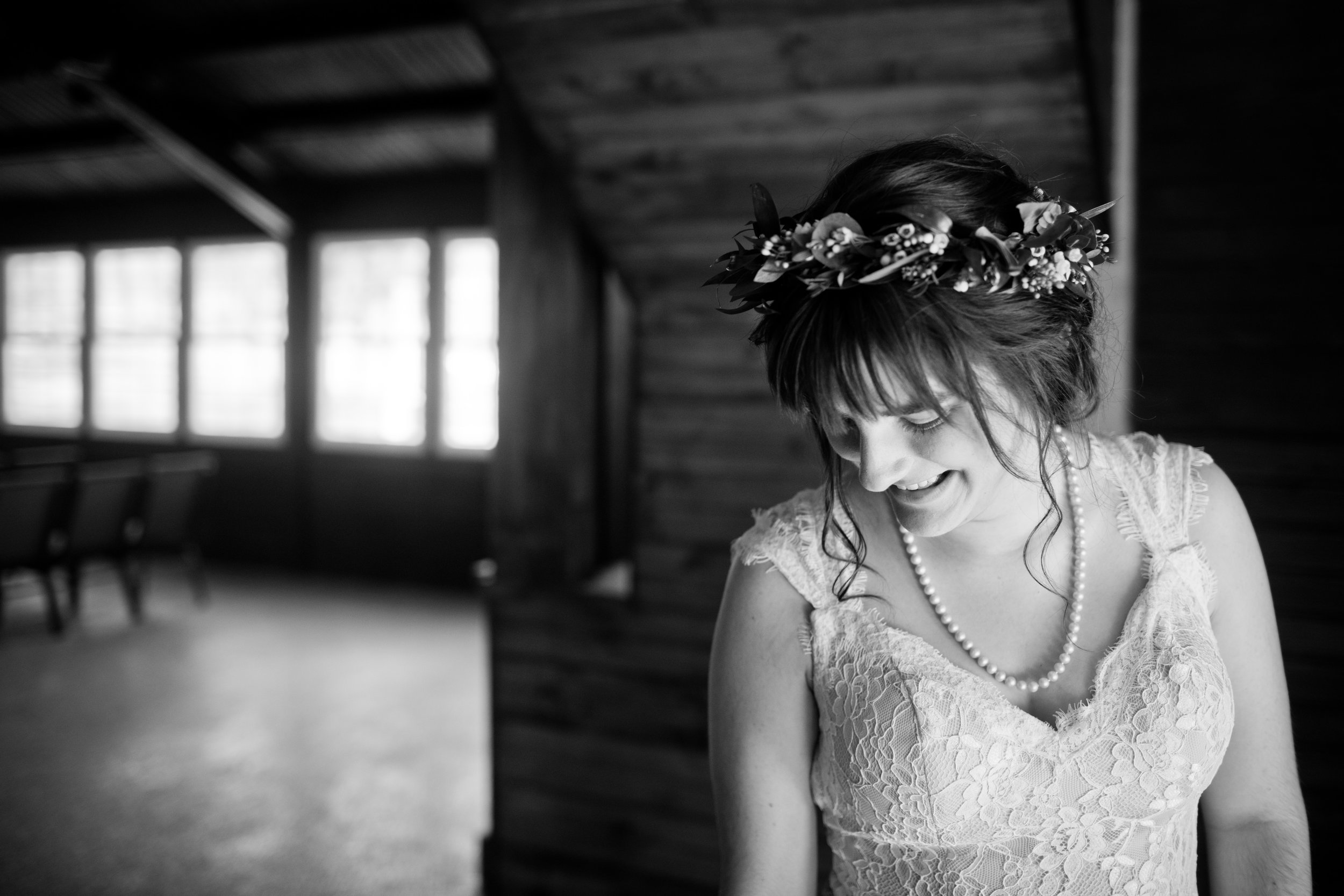bride in country chapel on wedding day with flower crown