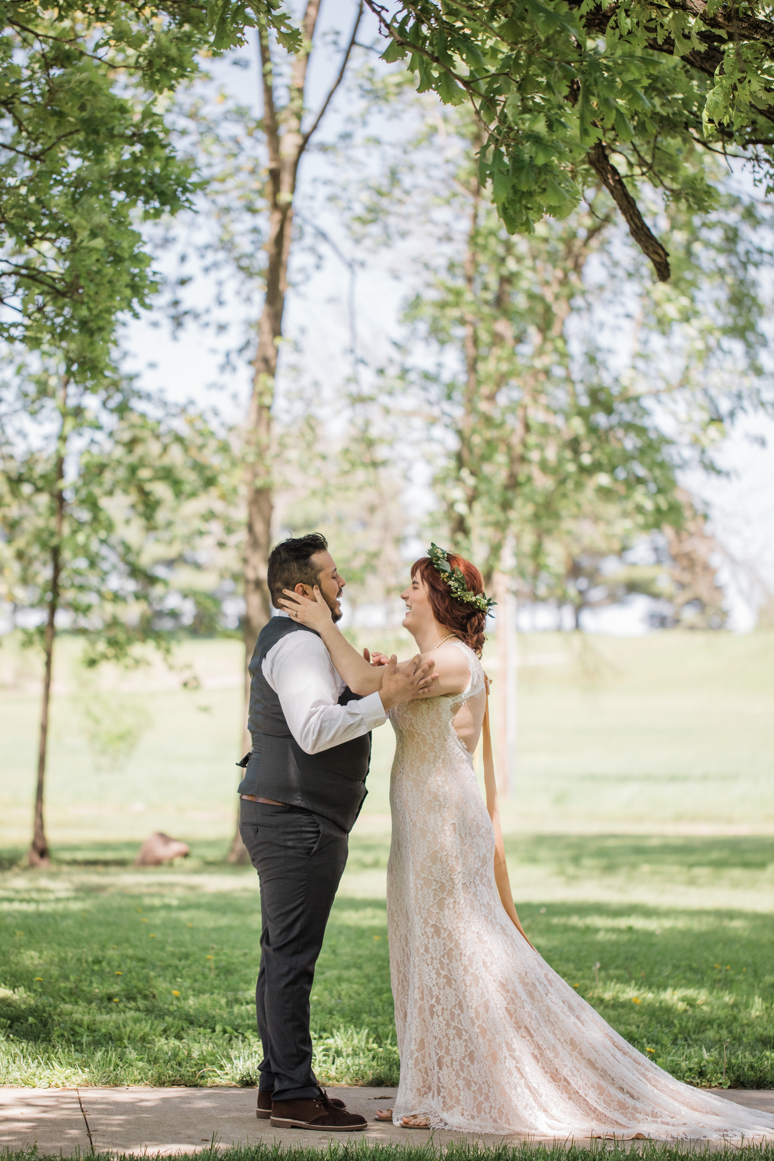romantic and emotional first look moments outside Riverside bible camp in Story City wedding