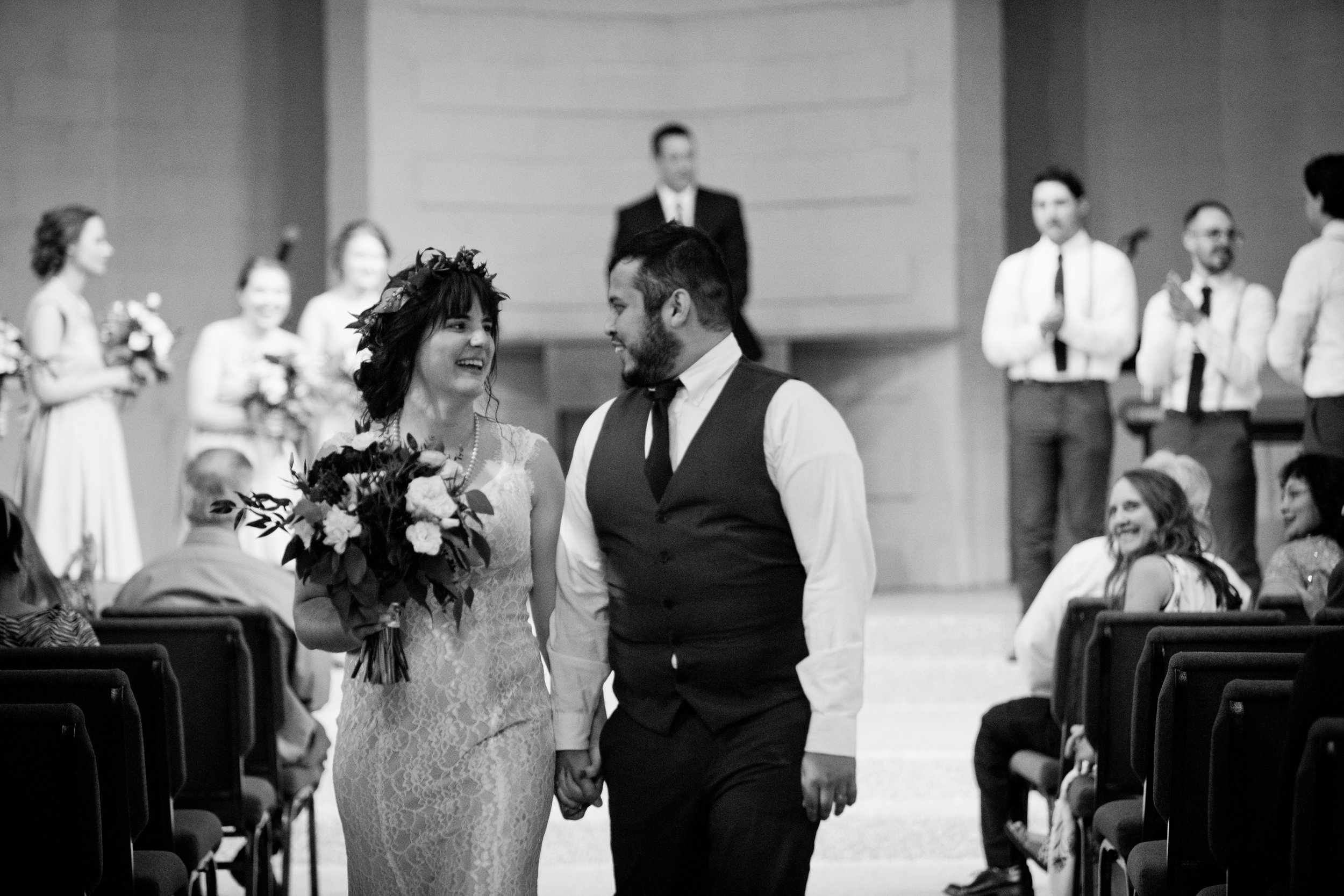 walking down the aisle after ceremony together