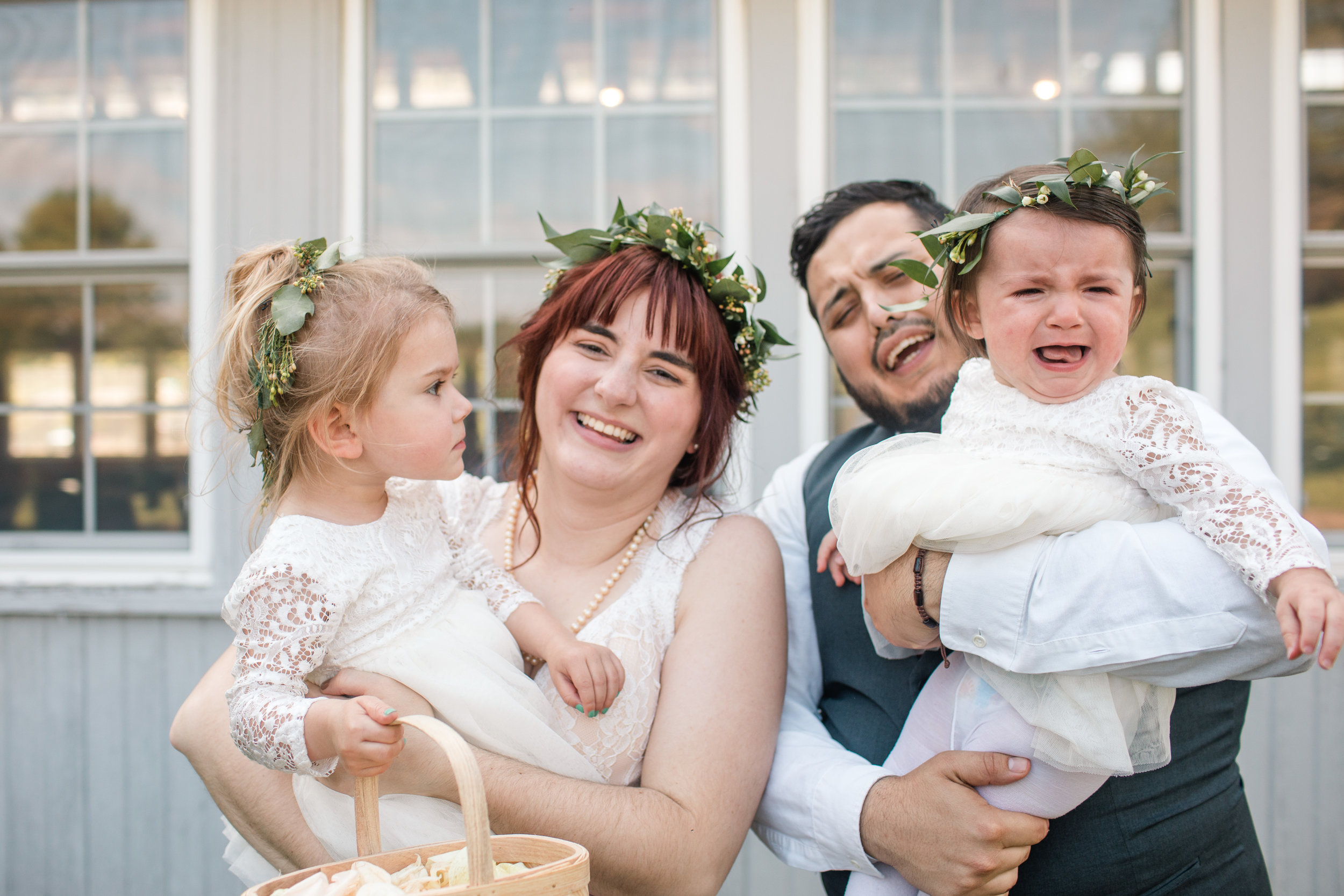 bride groom and flower girls crying