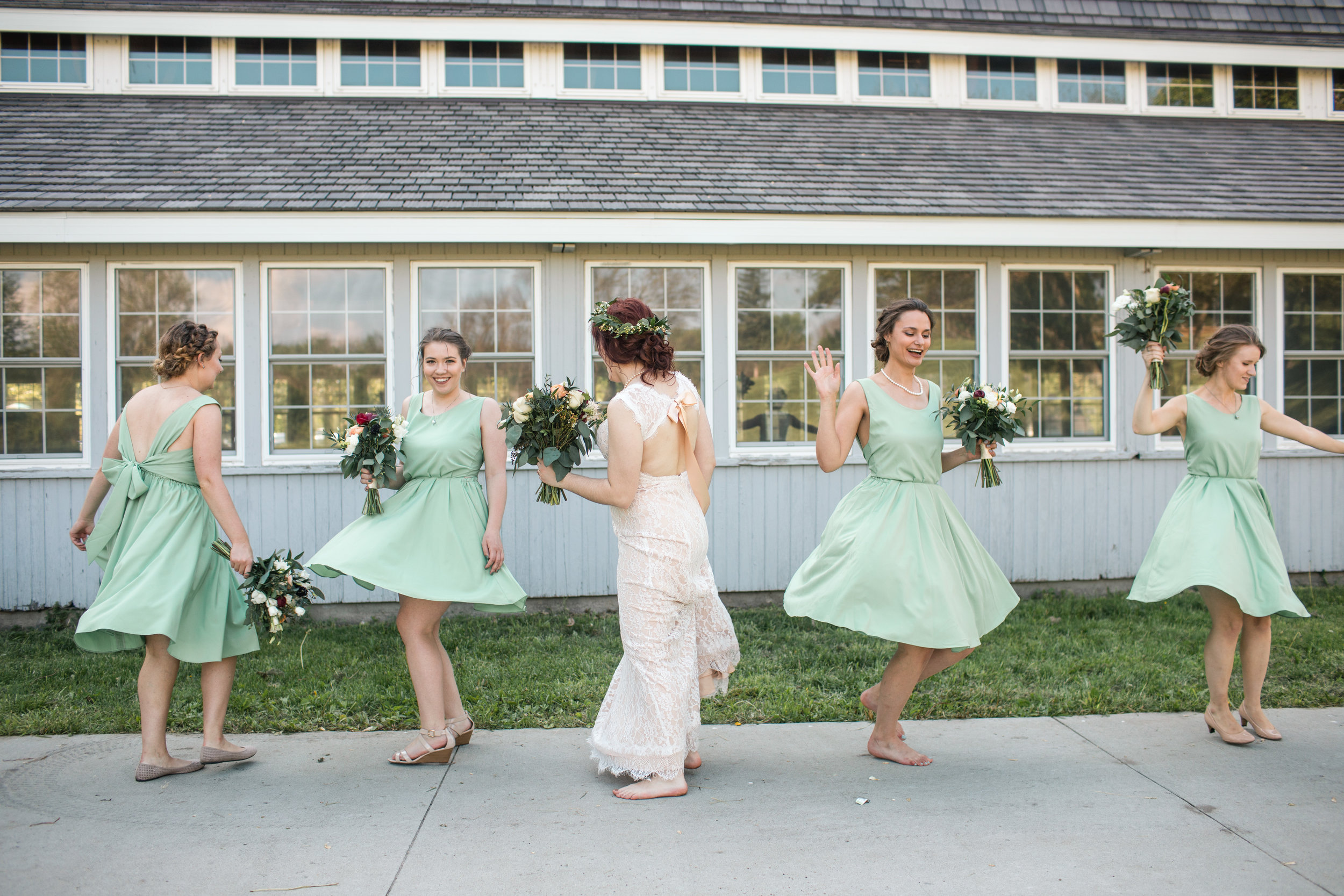 bridesmaids twirling with the bride candid des moines iowa weddings