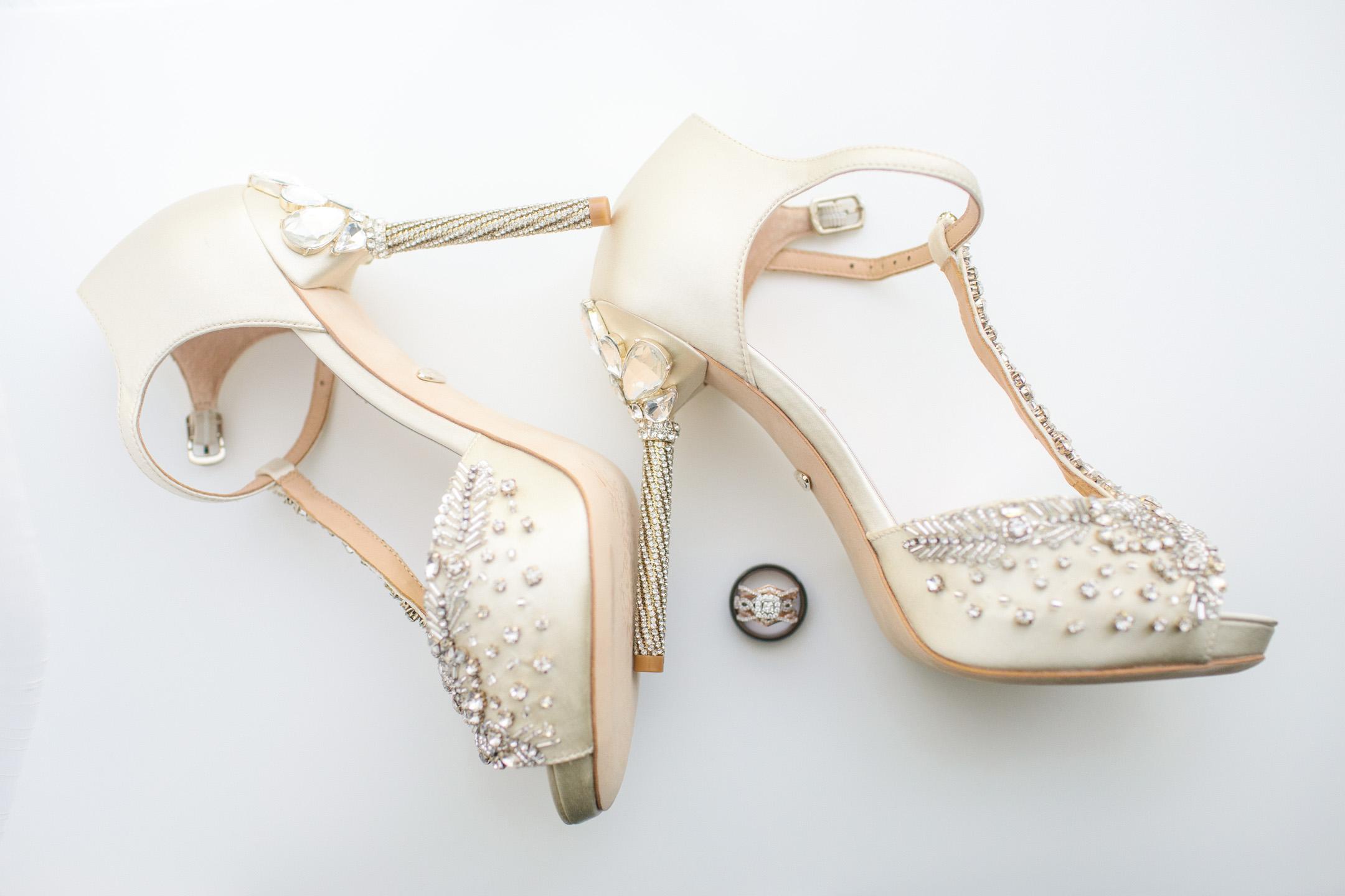 wedding shoes and wedding rings flatlay