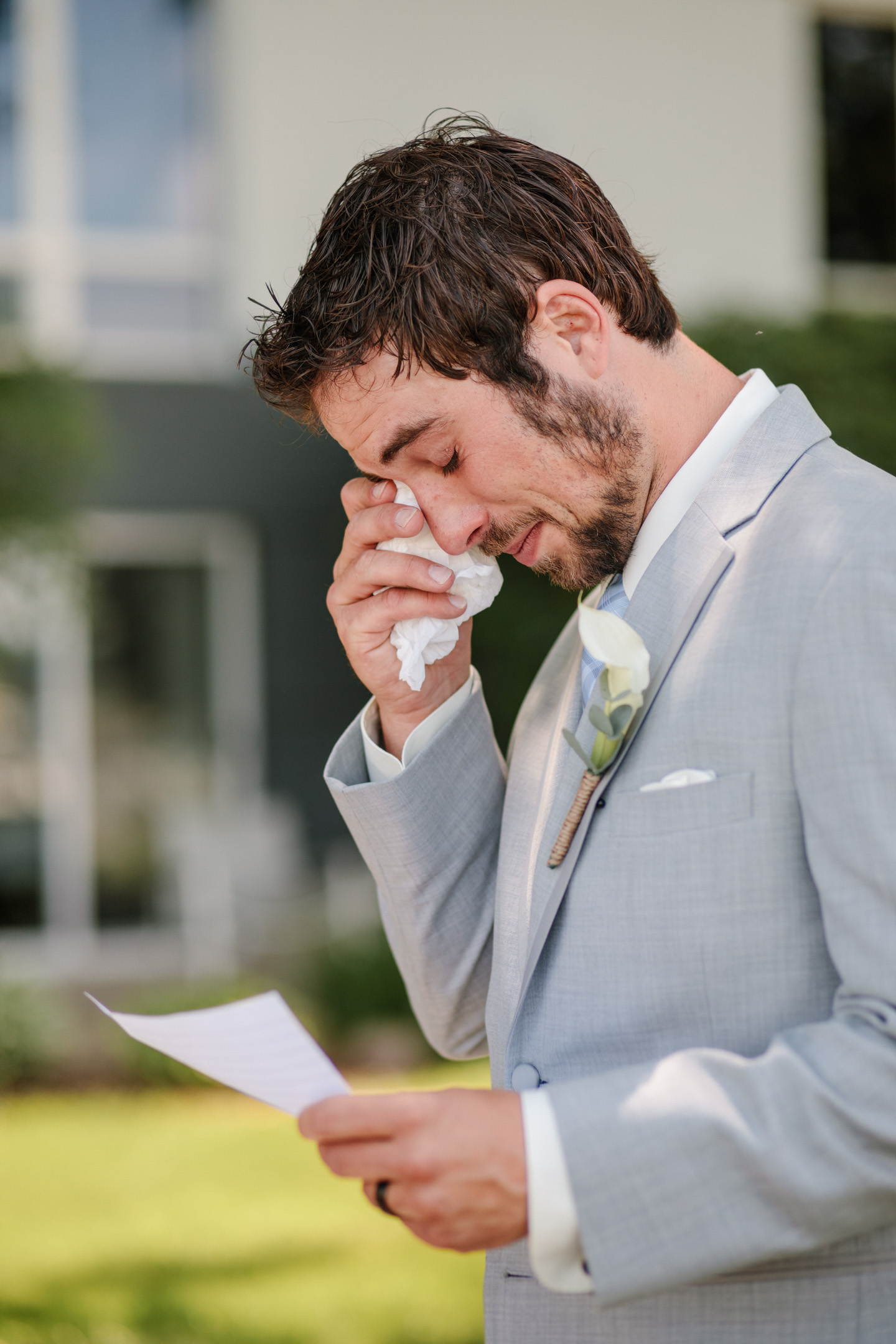 groom crying at letter from wife on wedding day