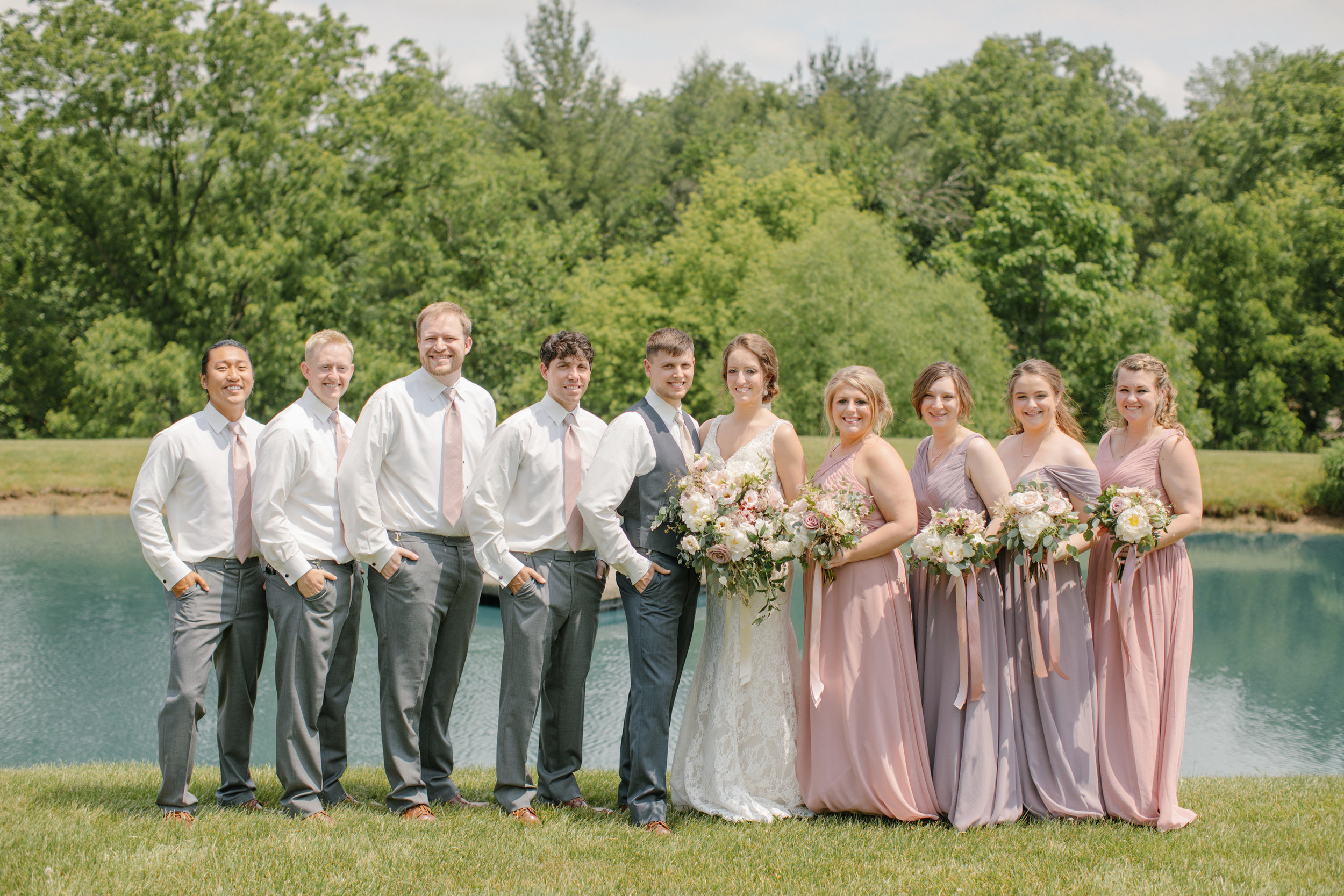 bridal party wedding photos pella iowa pink and purple dresses