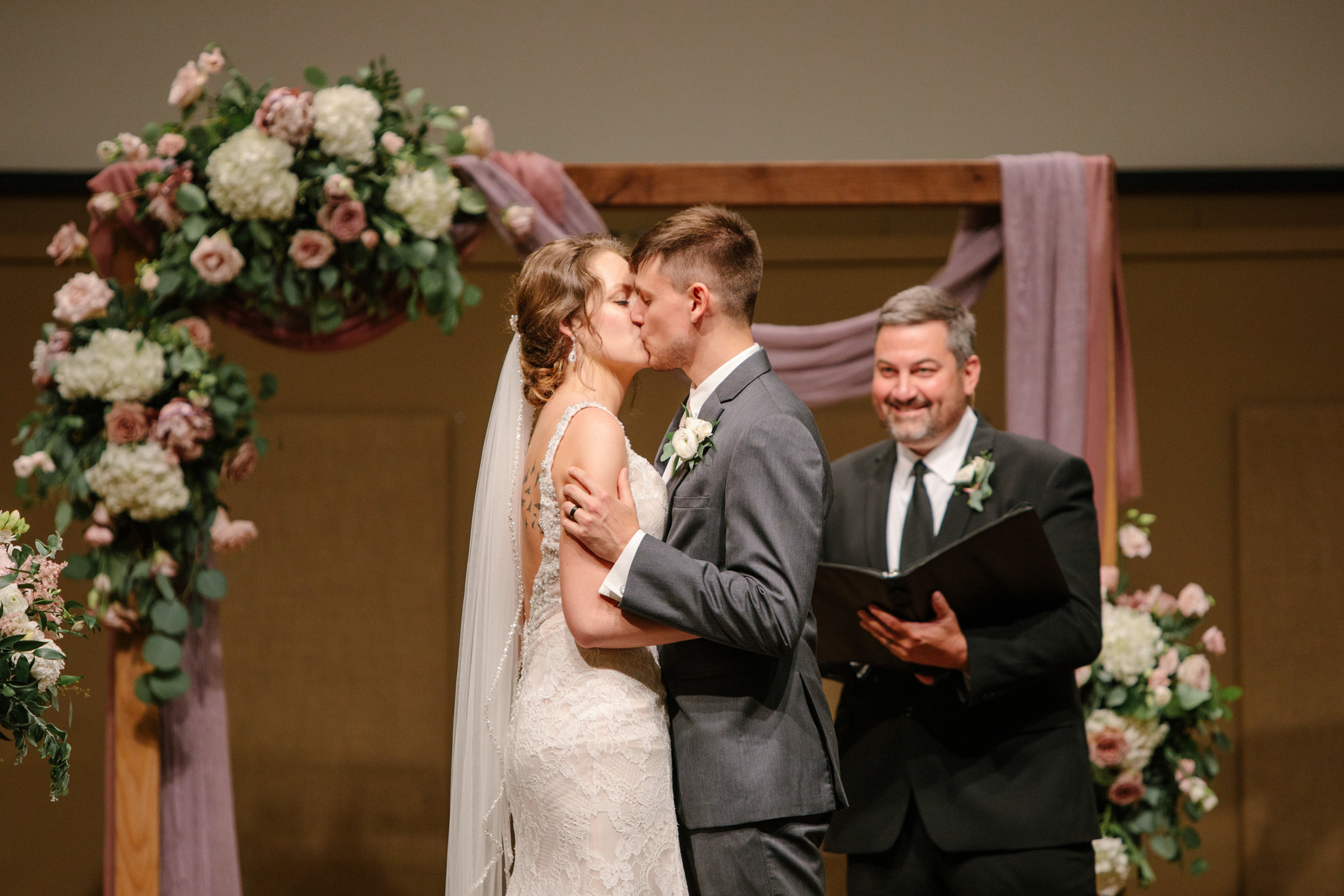 kiss at the alter with floral background