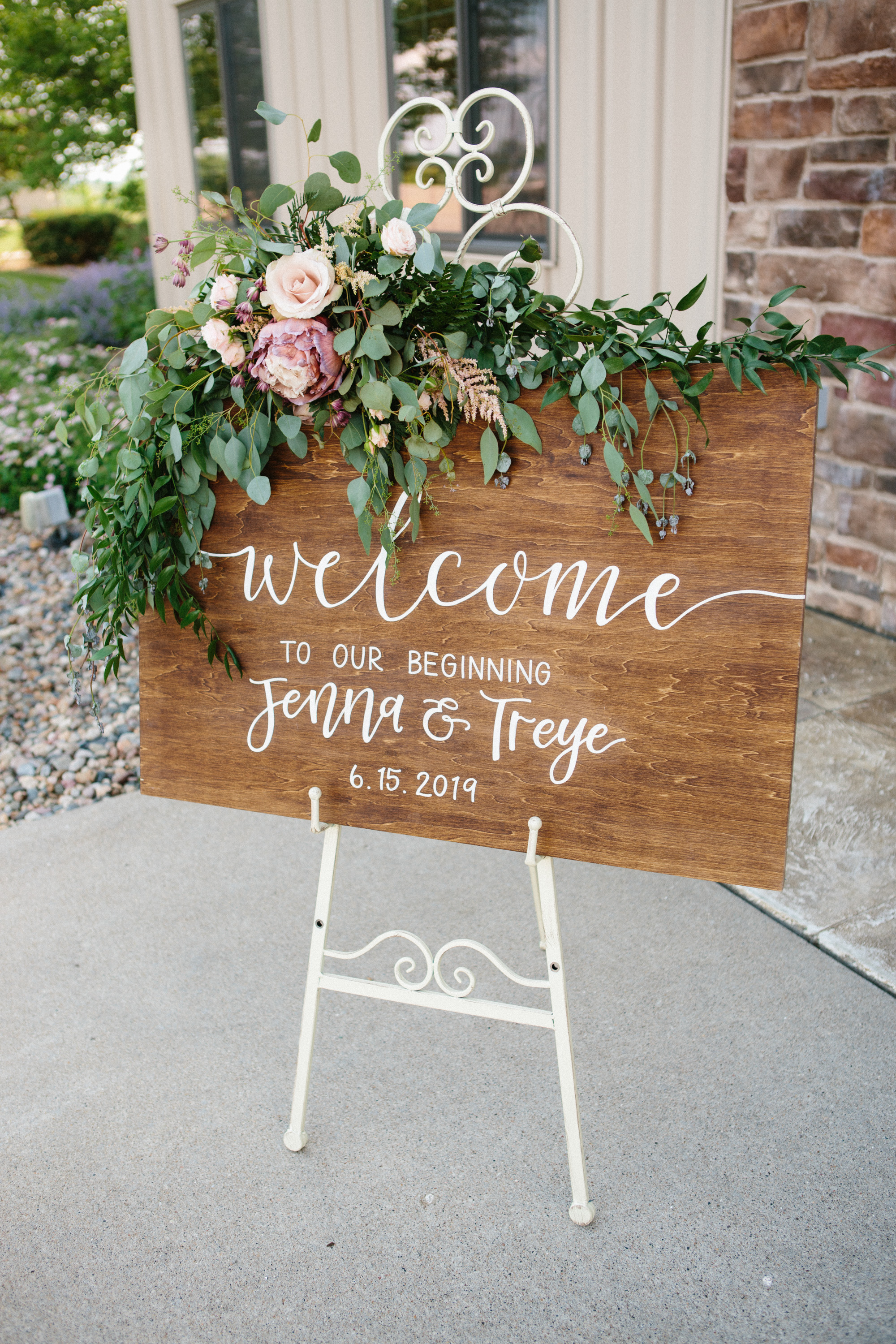 WOOD SIGN for wedding ceremony with flowers on it