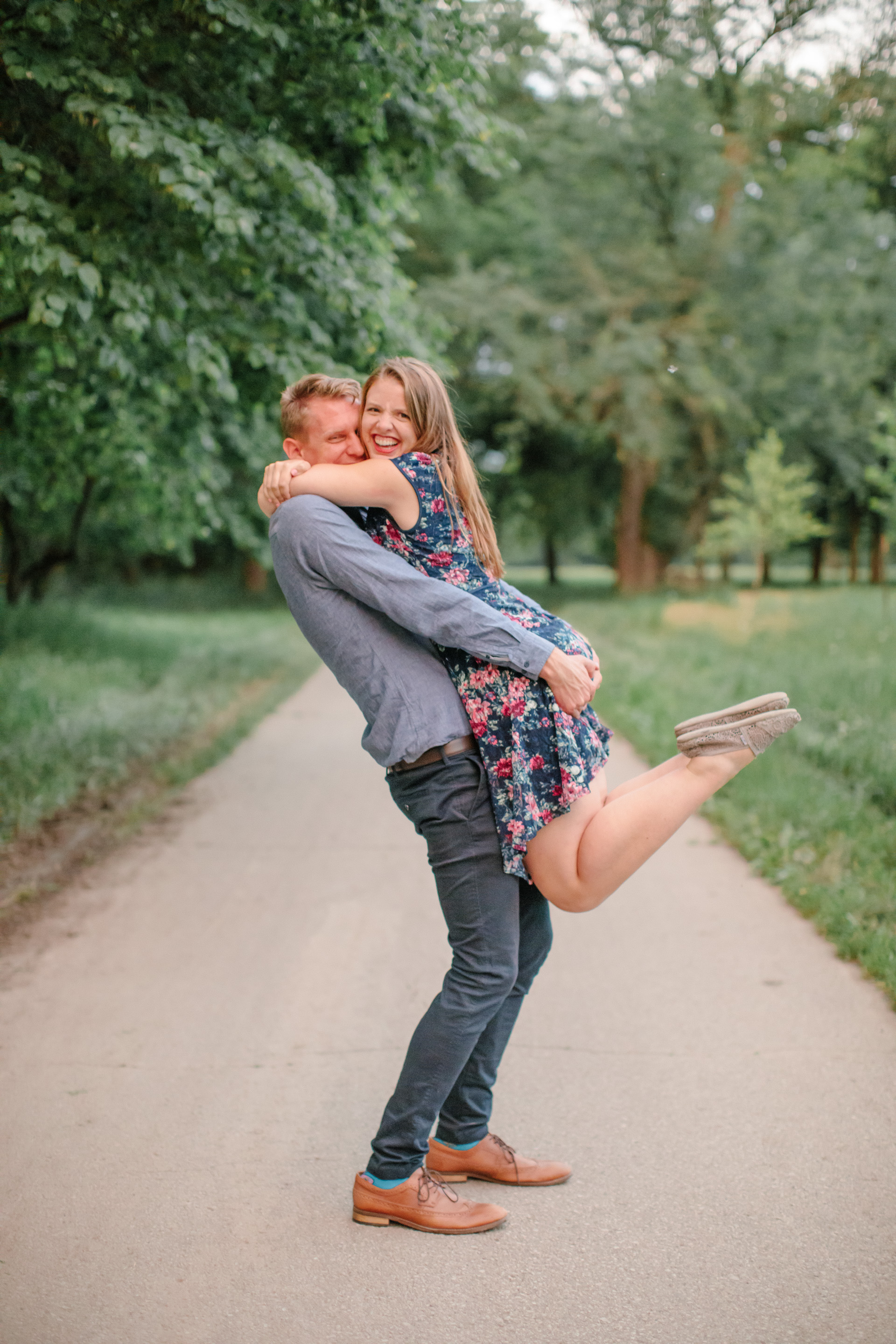 tall guy short girl engagement photo poses