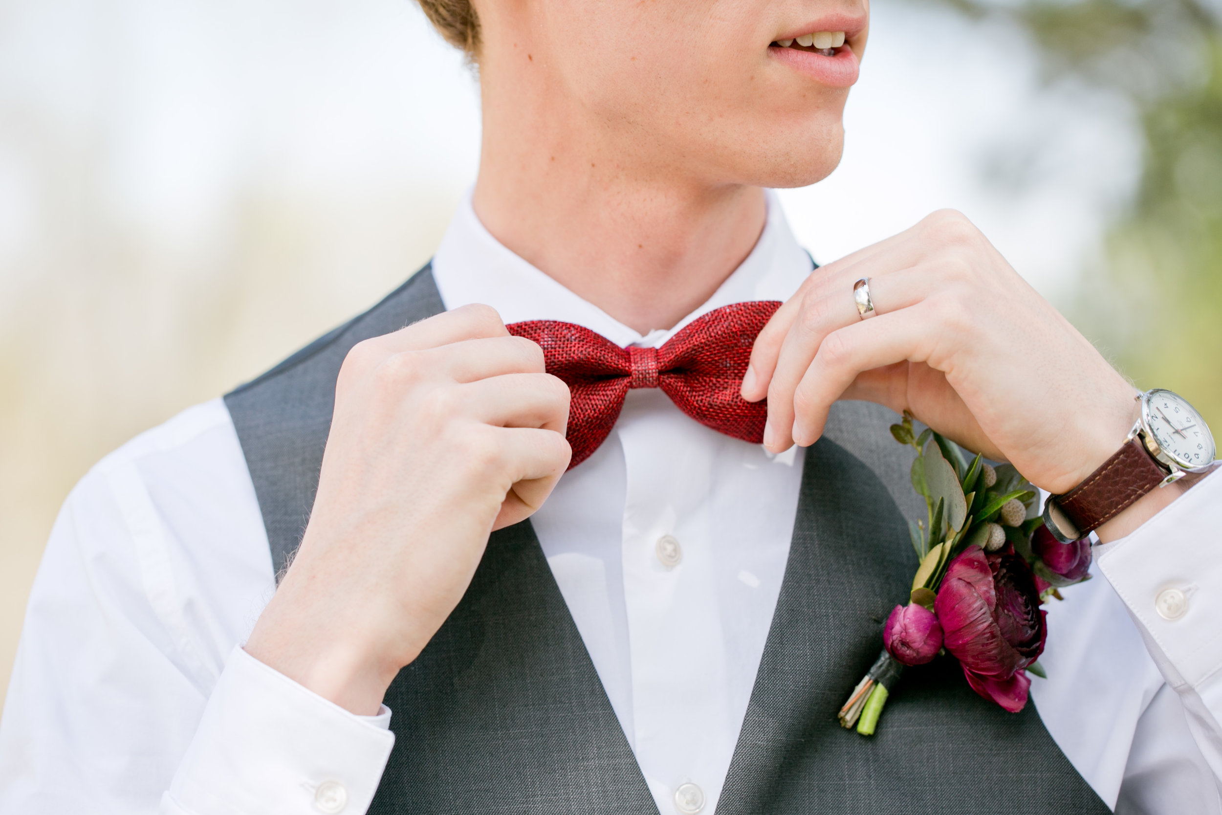 des moines iowa wedding photos red bowtie and watch on groom