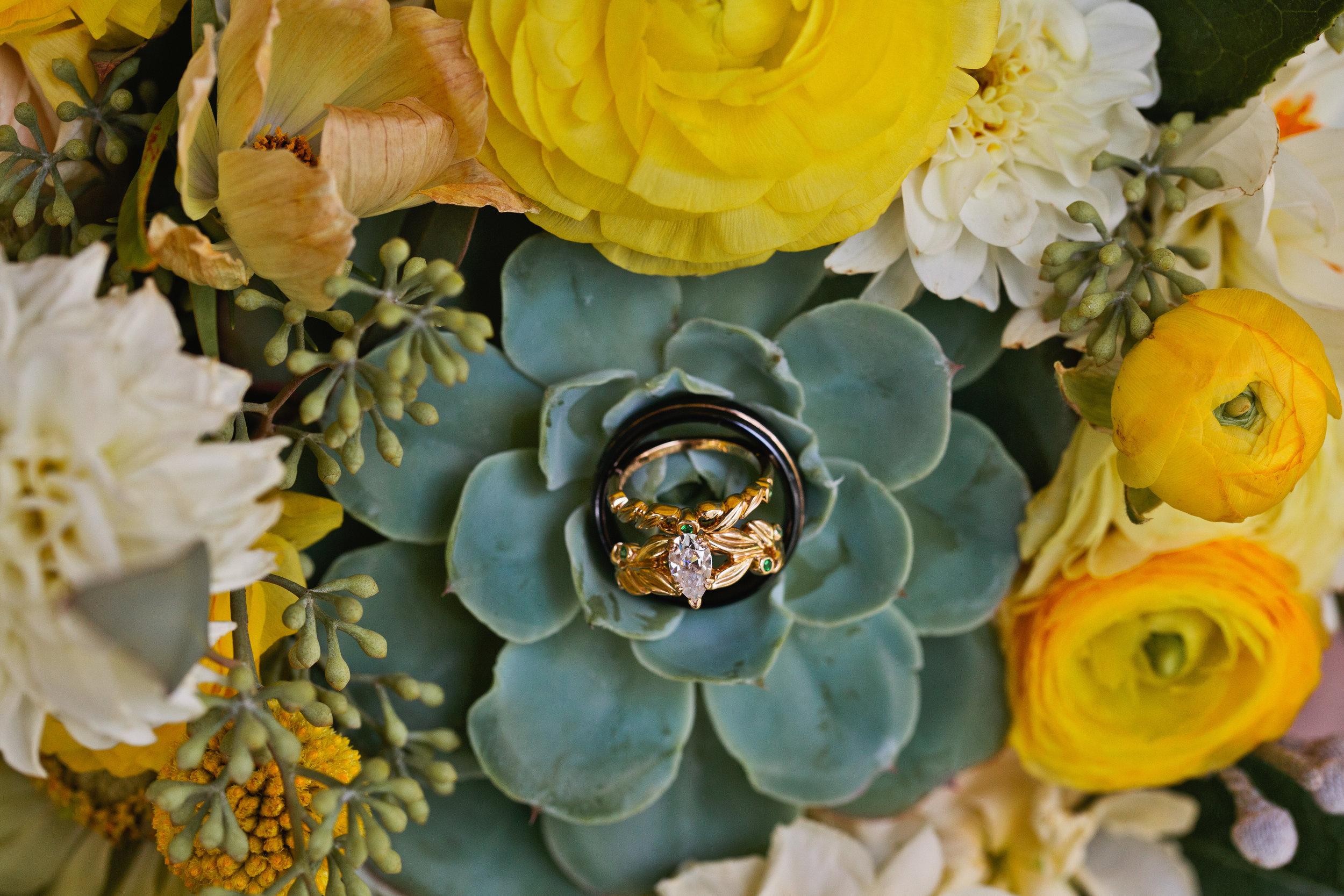 wedding rings unique on succulent in flower bouquet