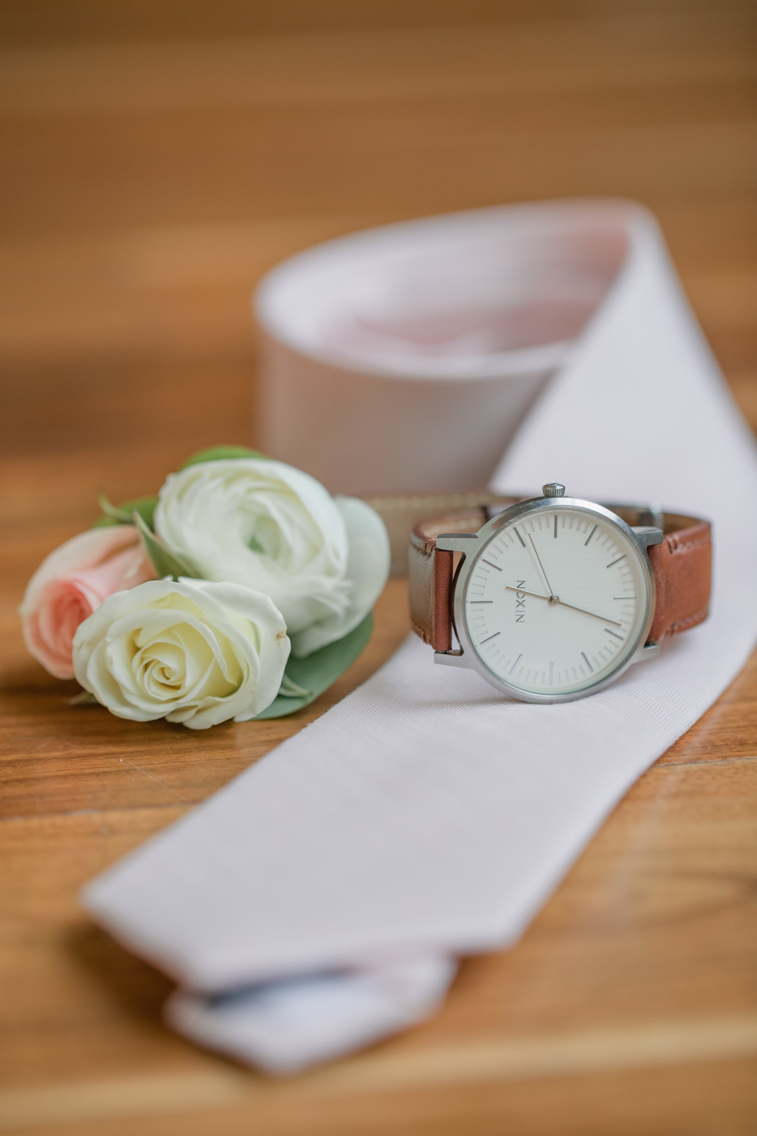 groom's flowers corsage and tie with watch