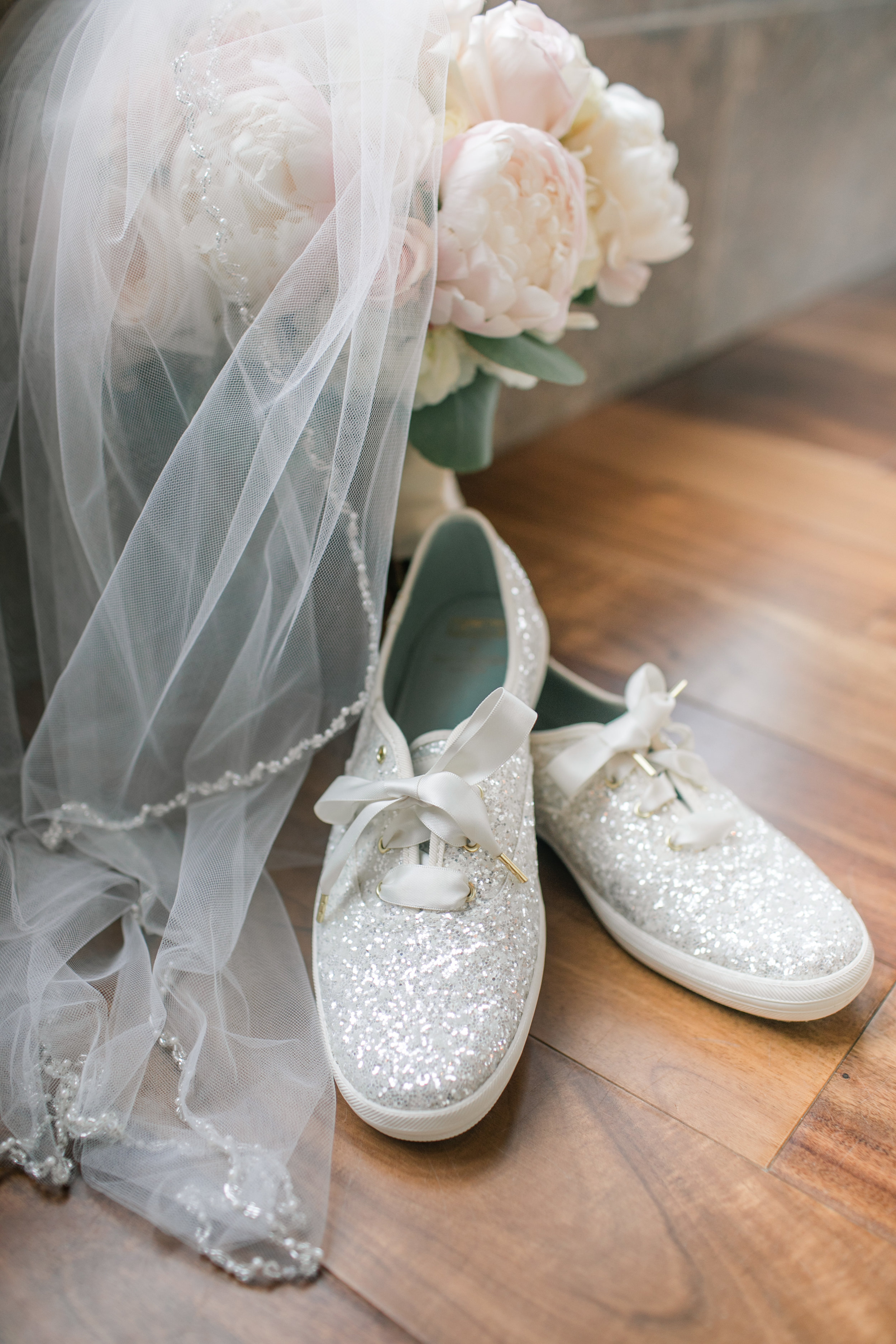 wedding details: flowers, glitter shoes, veil