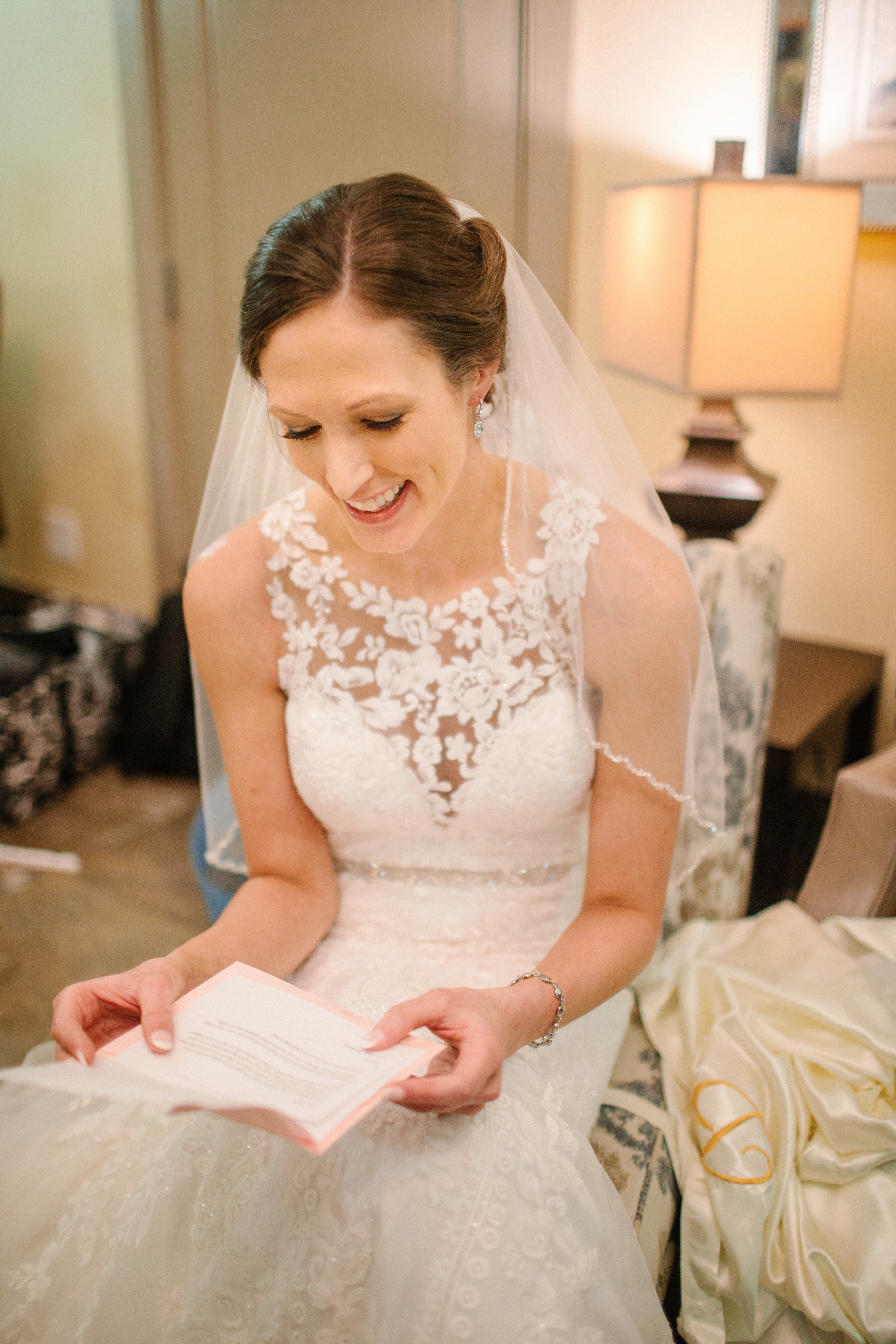 bride reading letter from groom on wedding day des moines iowa photography