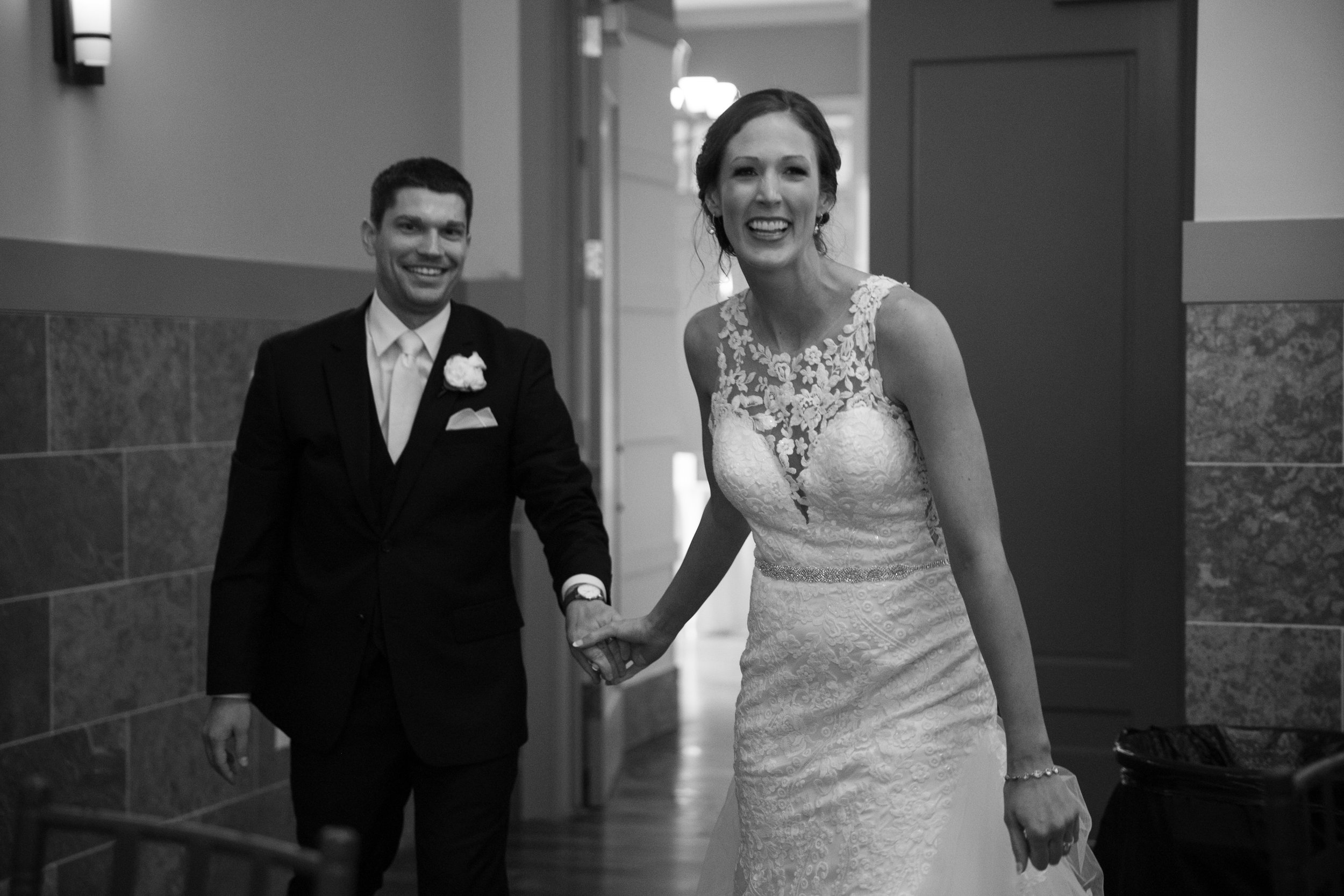 bride and groom entering reception des moines iowa norwalk