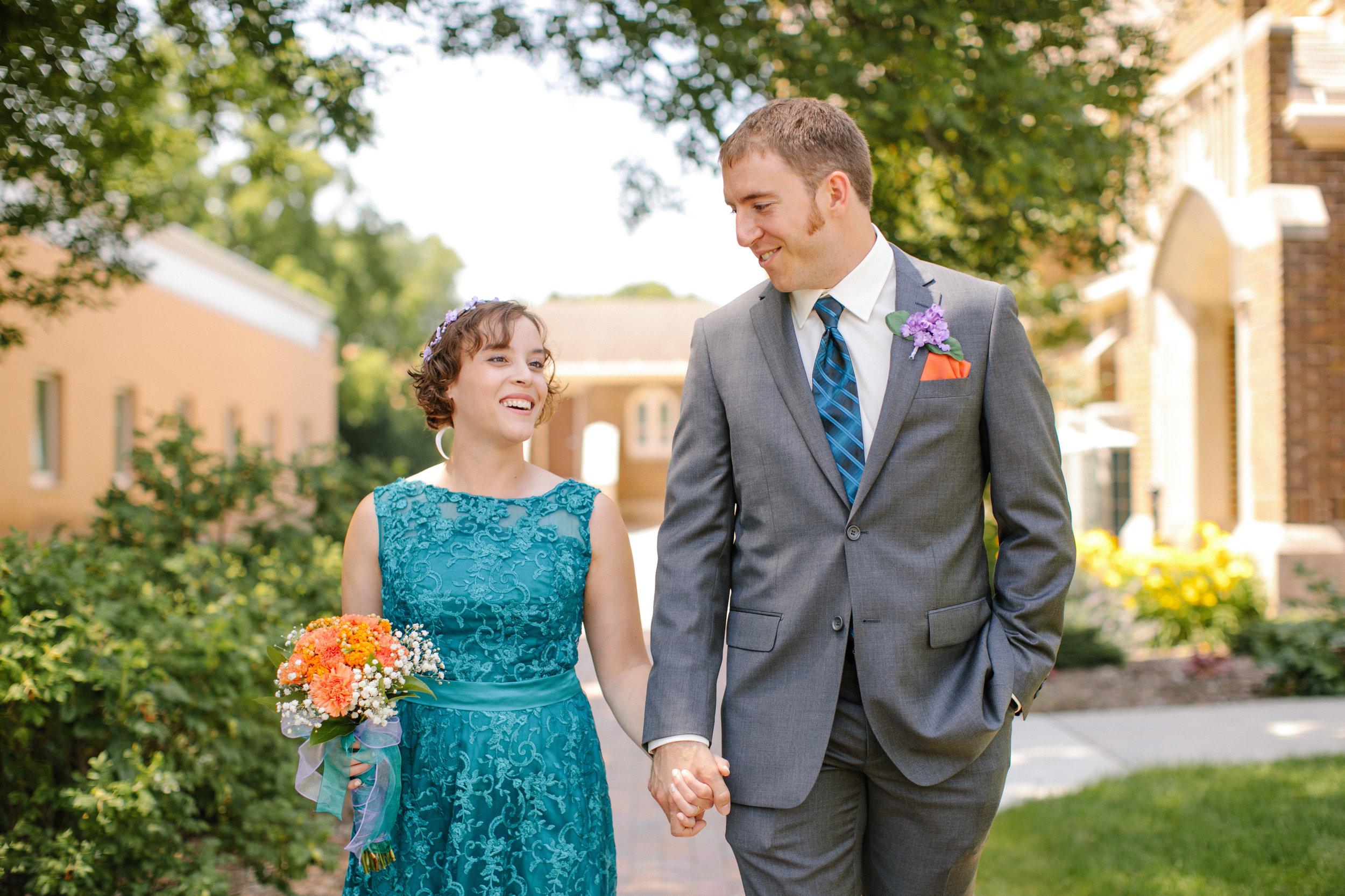 walking hand in hand on wedding day minnesota photographers