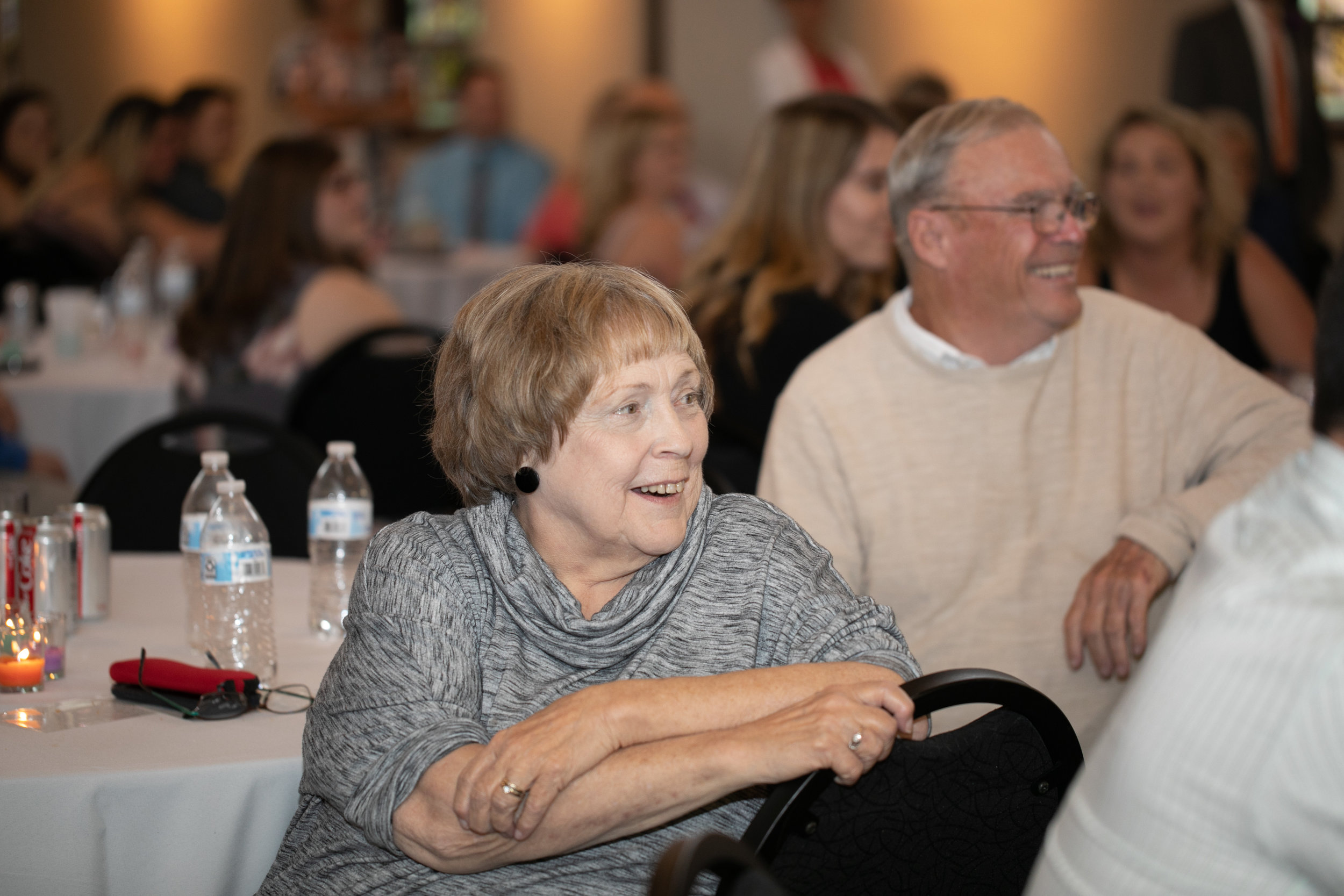grandma laughing during toasts wedding photographers in St Paul