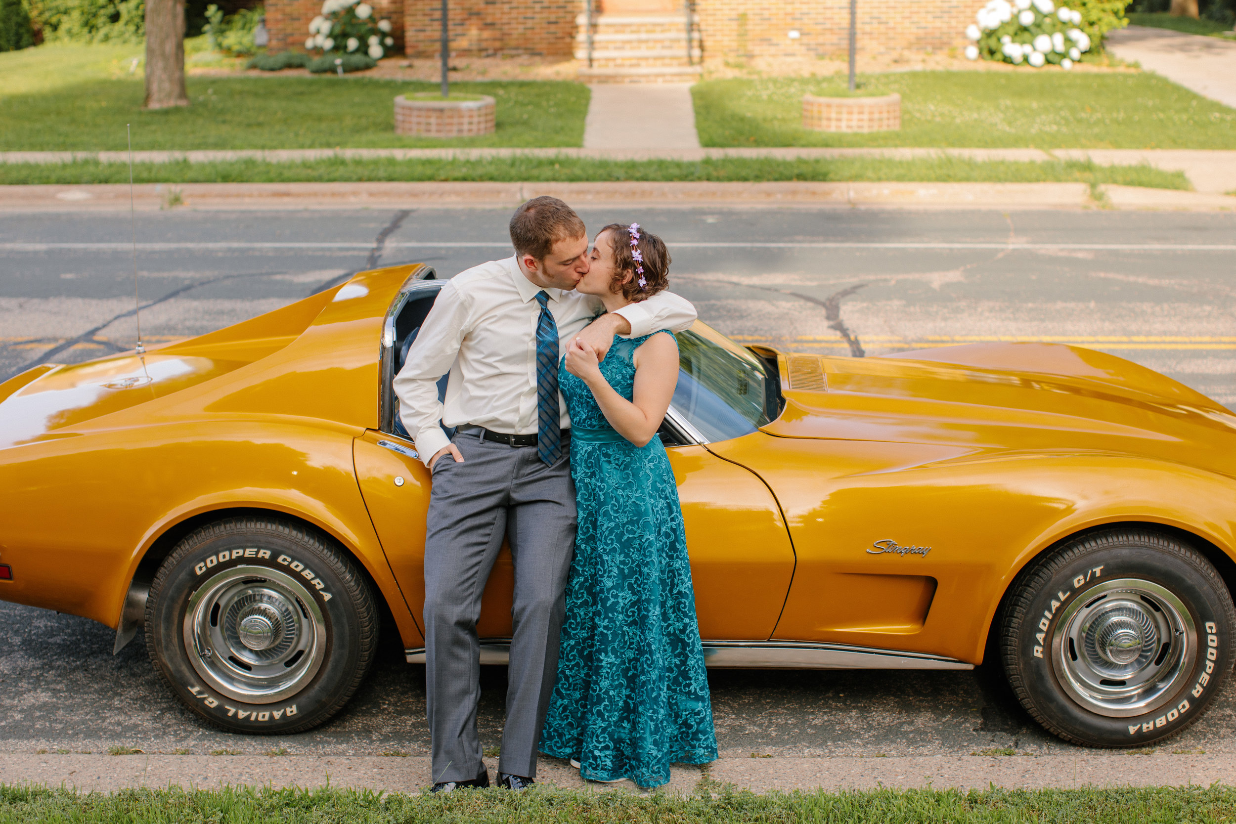 kissing in front of vintage car