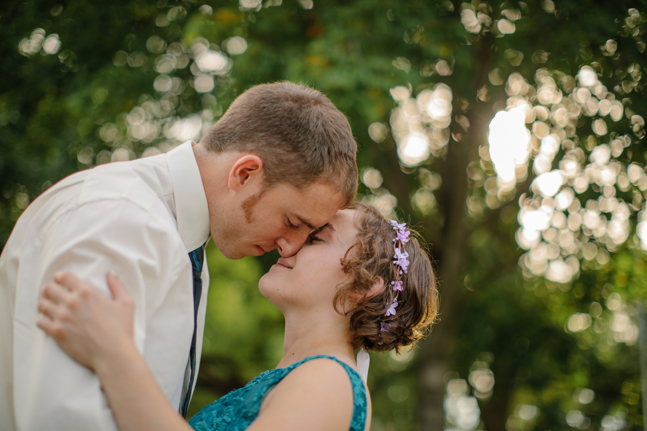 noses together bride and groom flower crown wedding day