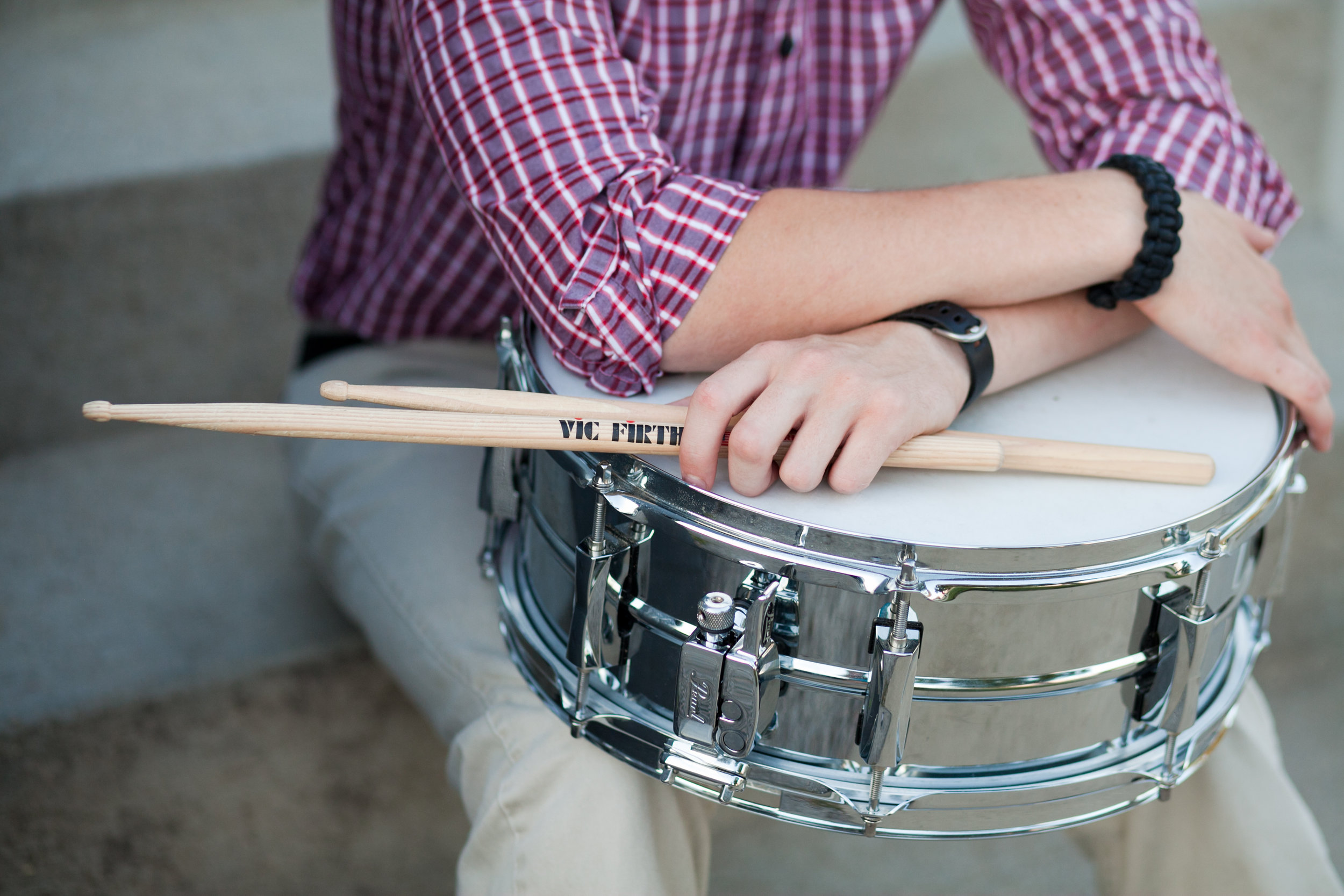 drummer with drum and drum sticks senior photos
