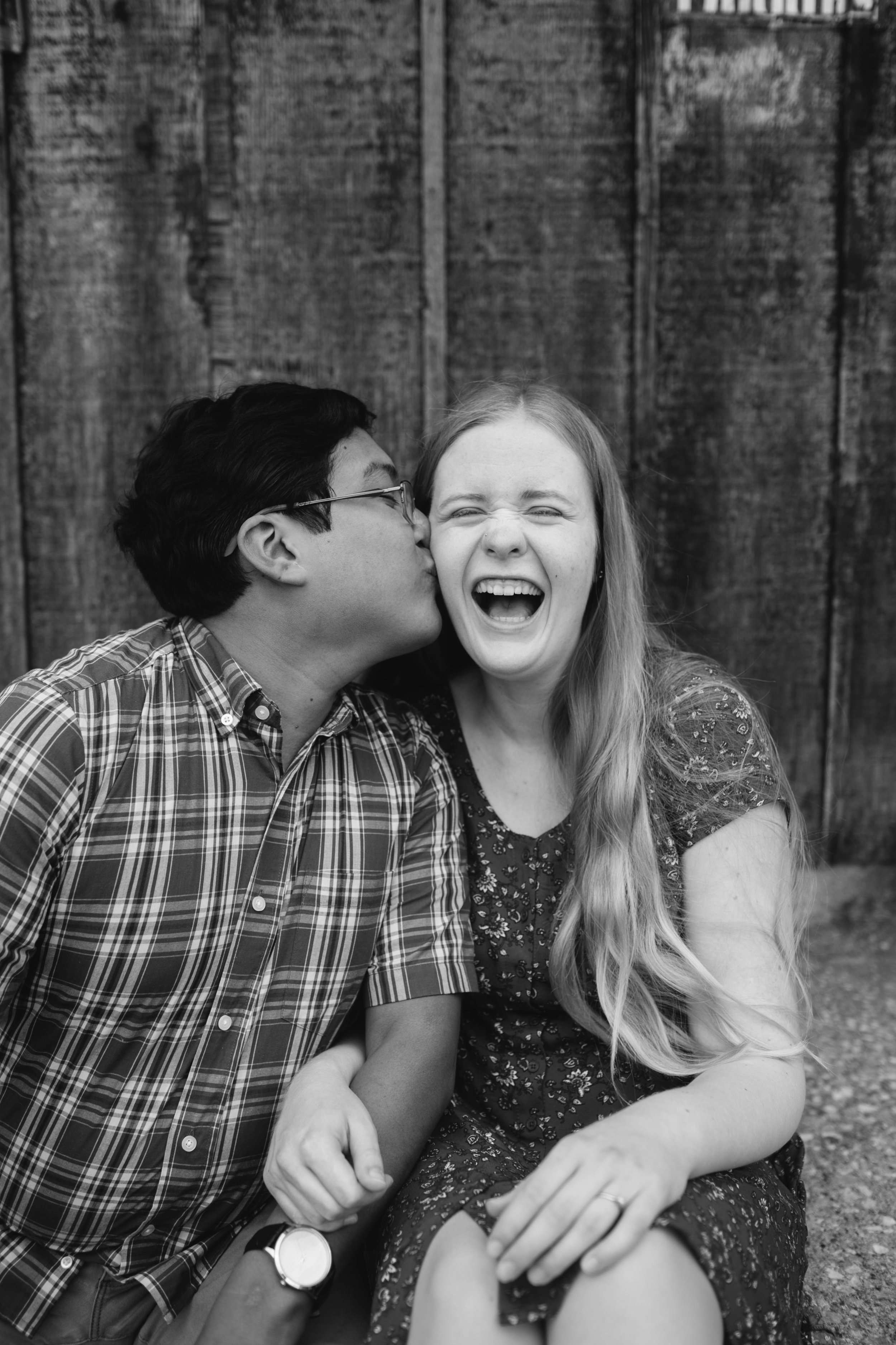 cute couple laughing iowa engagement pictures