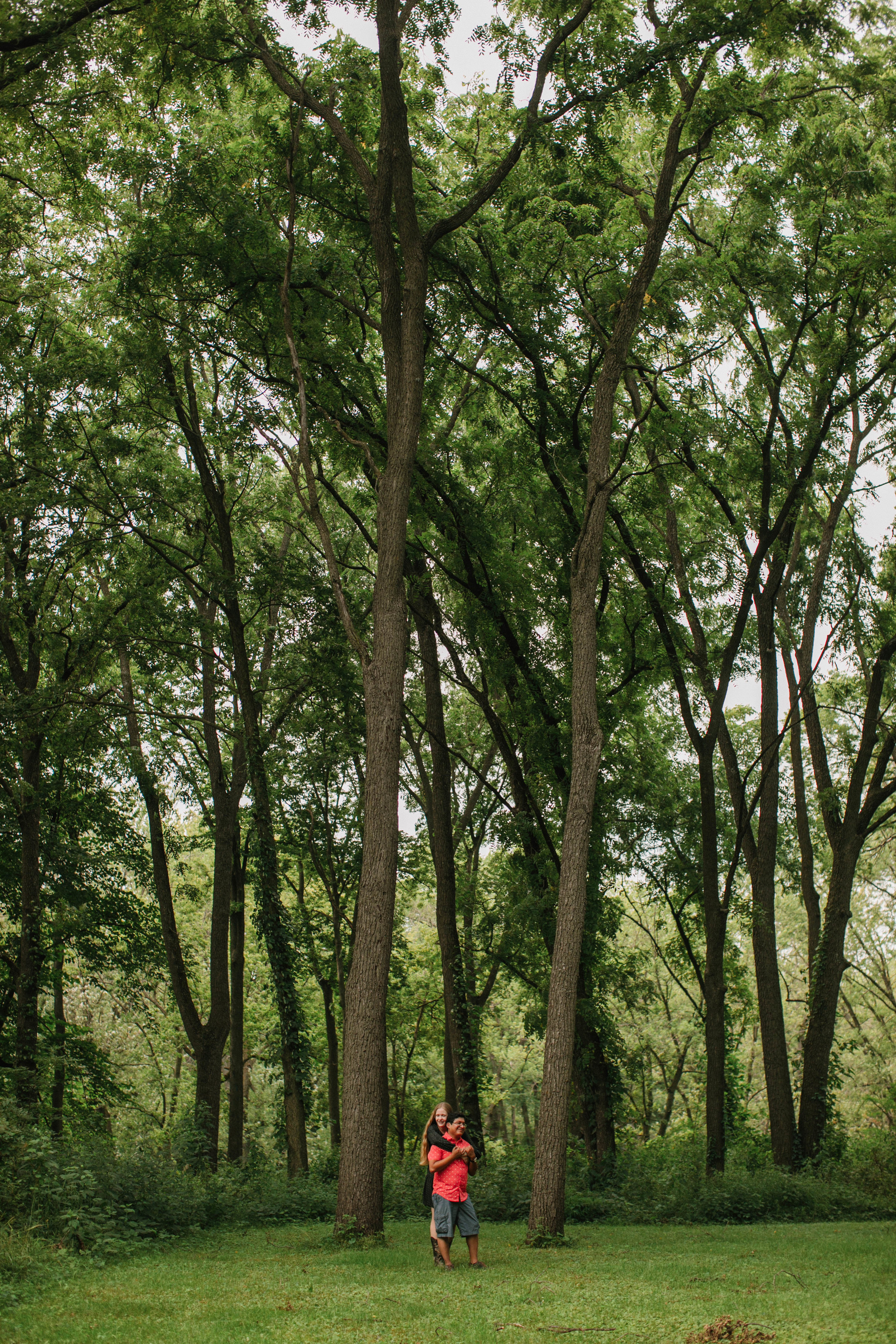 wooded area engagement photos in cedar falls