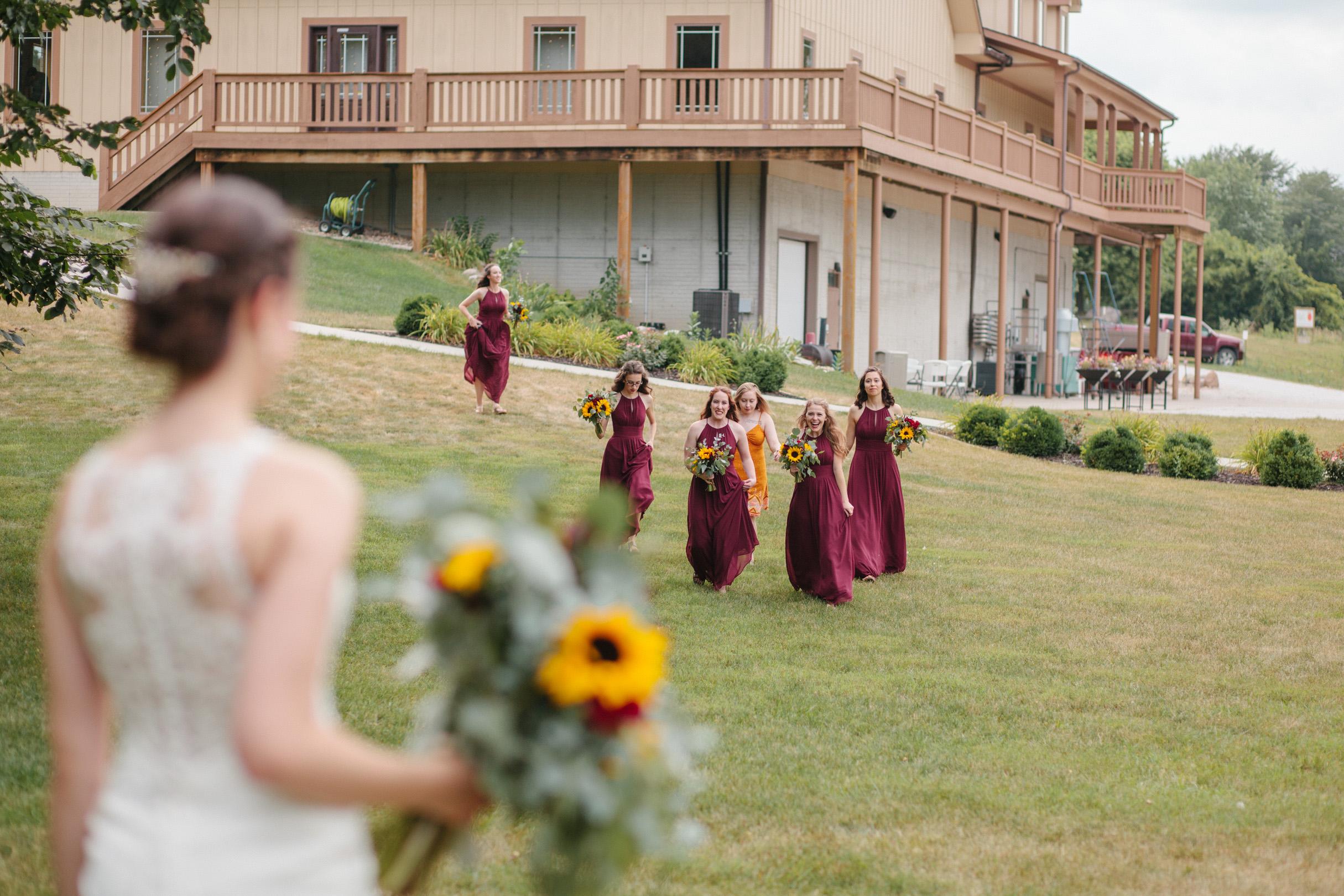 bridesmaids running towards the bride