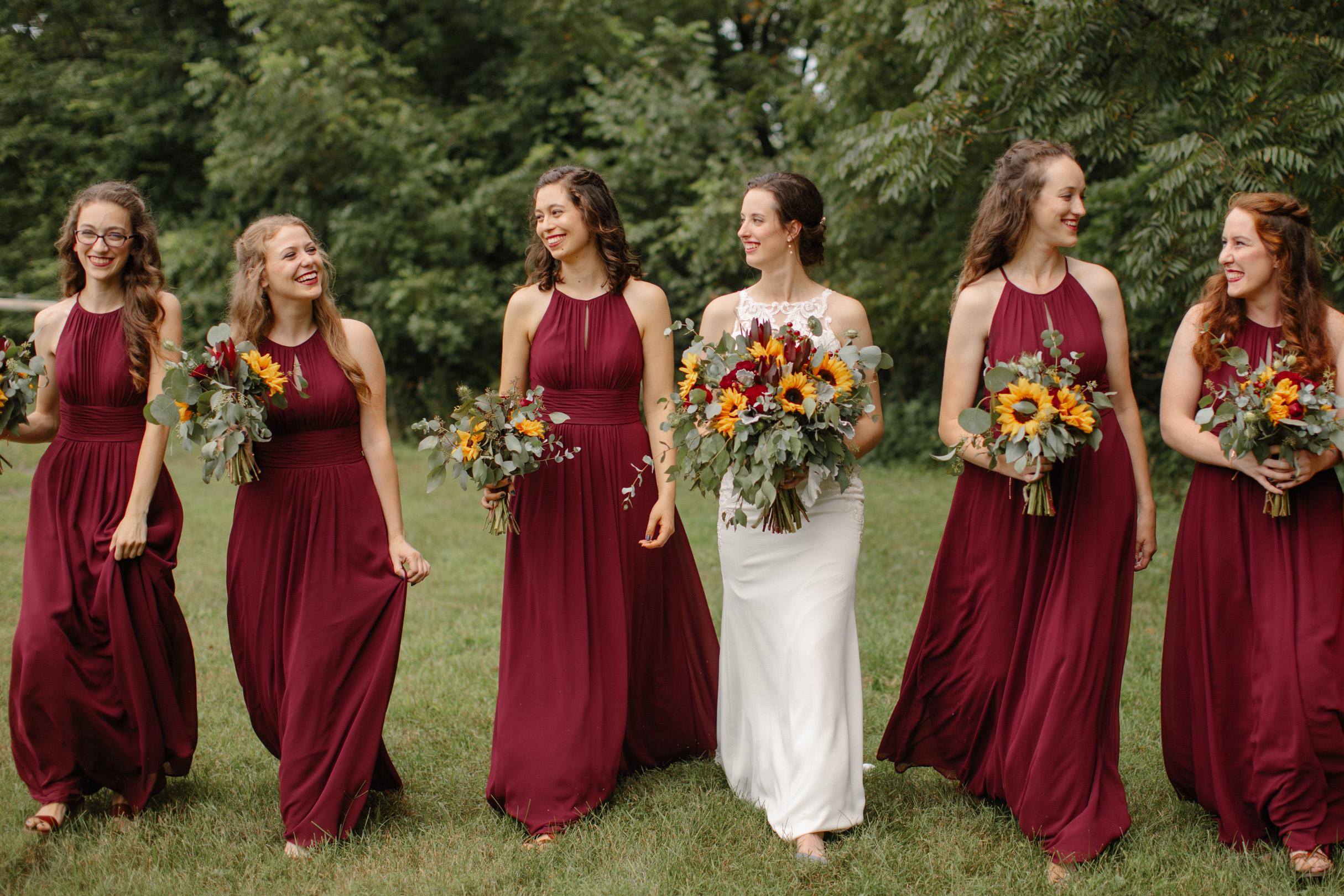 elegant bridesmaids walking together with bride des Moines wedding photography