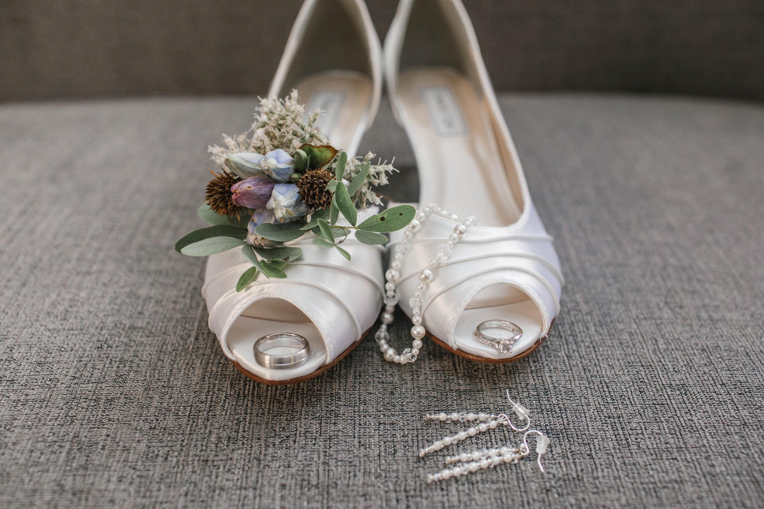 why photographers should take detail photos of bride's dress shoes flowers and details