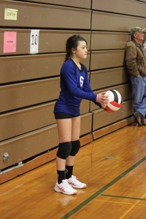 Kate getting ready to serve in a recent Volleyball match.