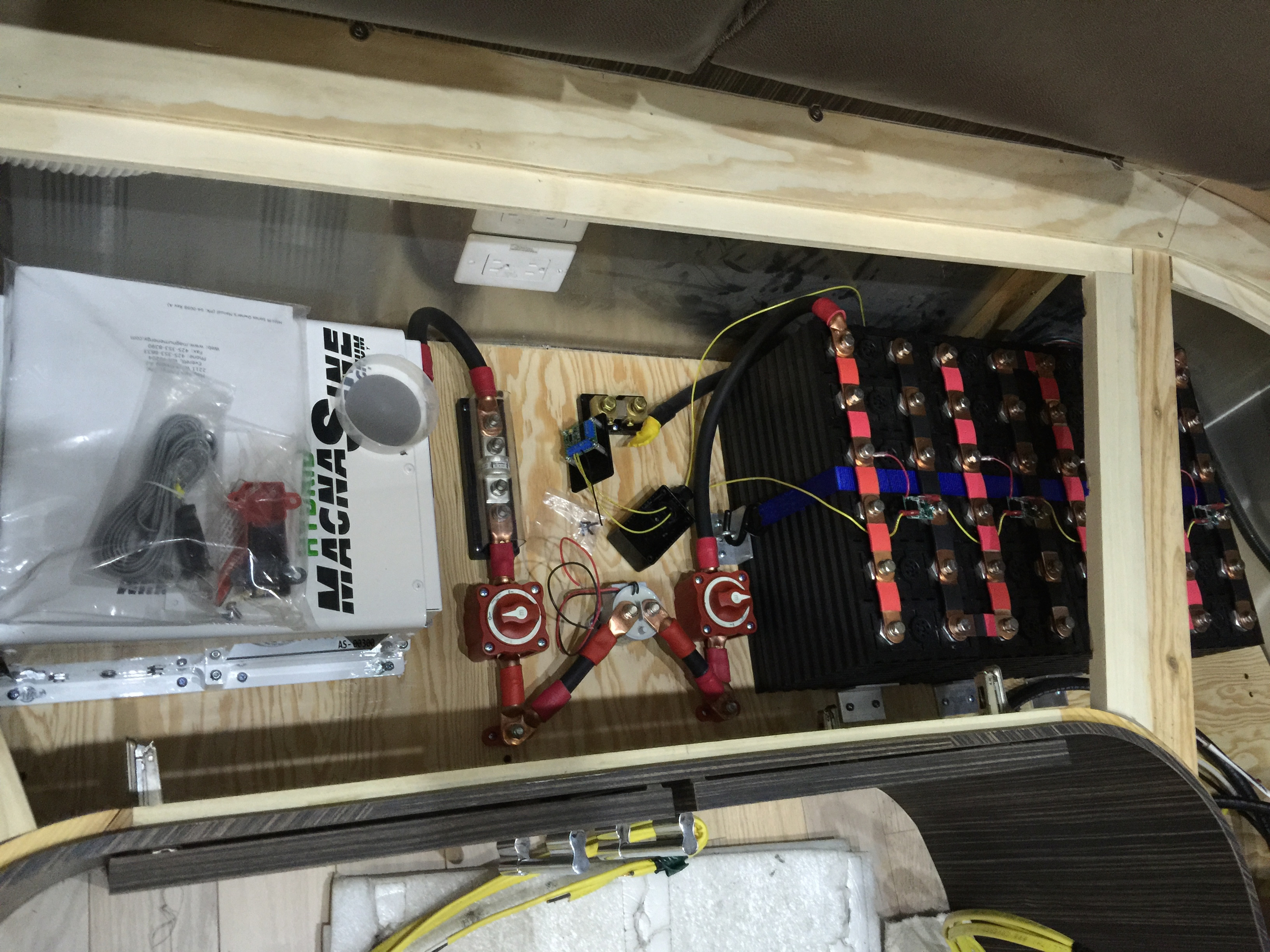 Being installed:  Magnum 3000-watt hybrid inverter, and 6 banks of lithium power cells (100 amp-hours  each).