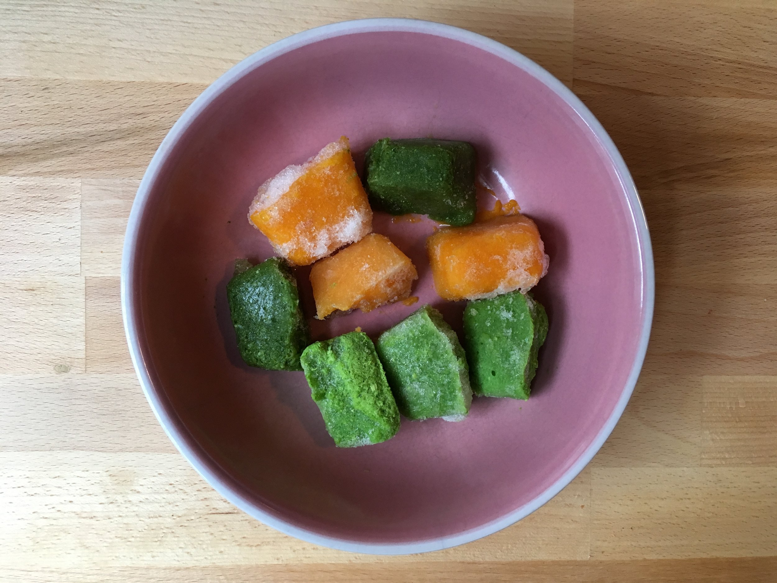 Purée ice cubes of peas, butternut squash, and green beans