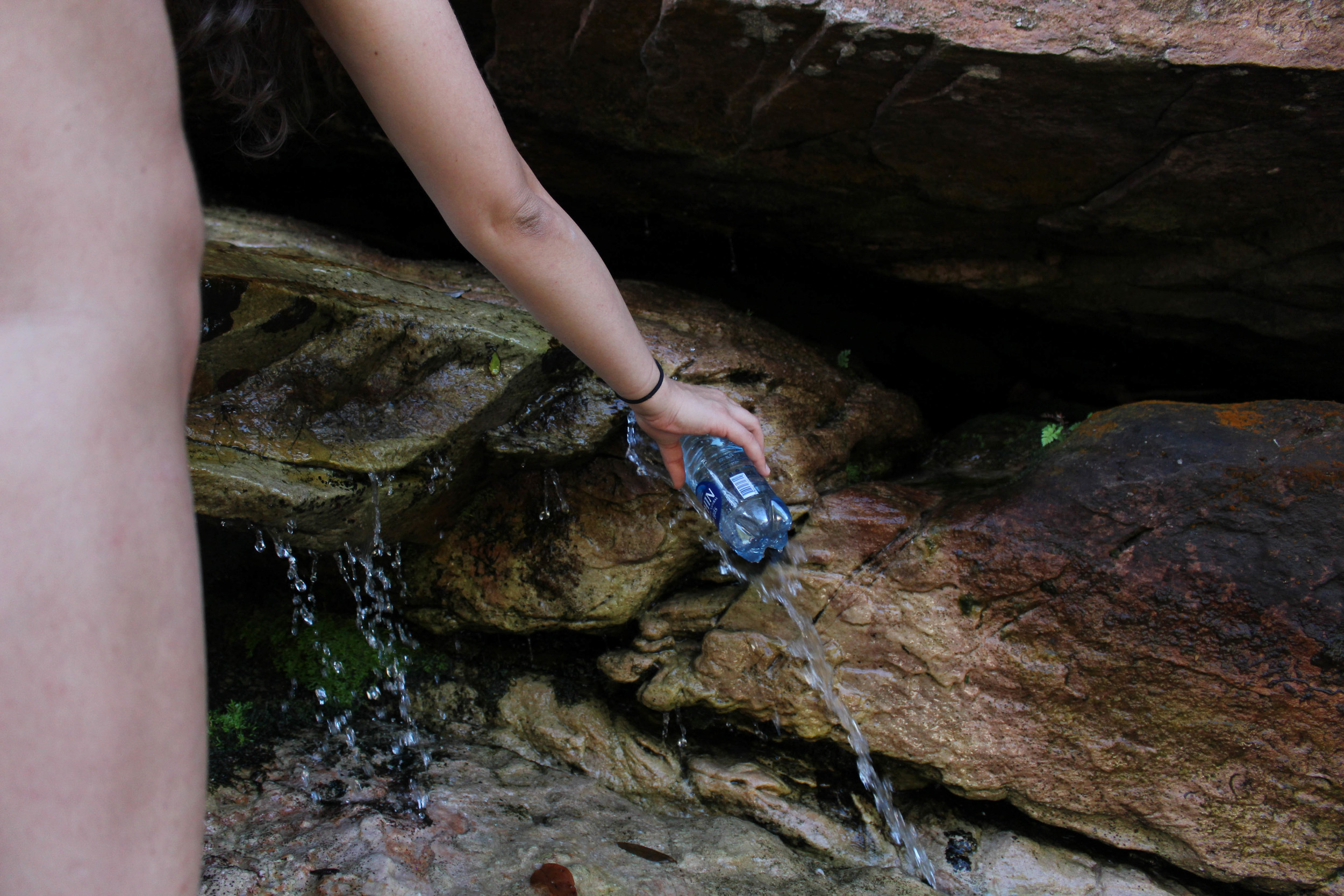 Filling our bottles with natural spring water. So refreshing and clean!