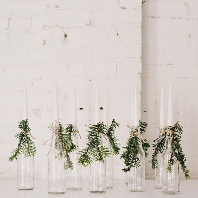 Decorations for the holidays don't have to be elaborate ... white candles with a sprig of evergreen is all you need to create a calm and and beautiful space.  #christmasspirit #simplethings  #setthestage #merryandbright