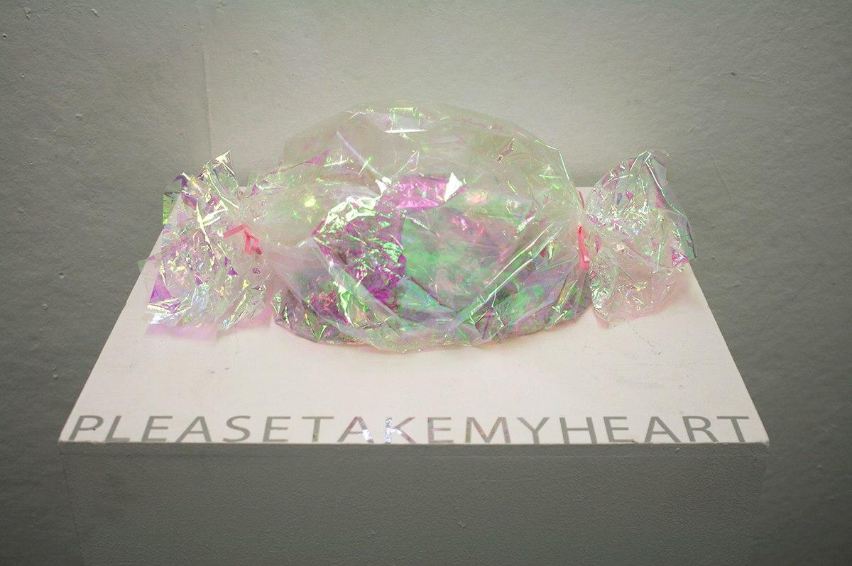 Sweet Liar   Broken glass, cello wrap, metallic paper    Dimensions variable    2013