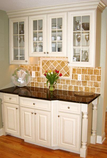 Glass Cabinets Tumbled Marble Backsplash optimized.jpg