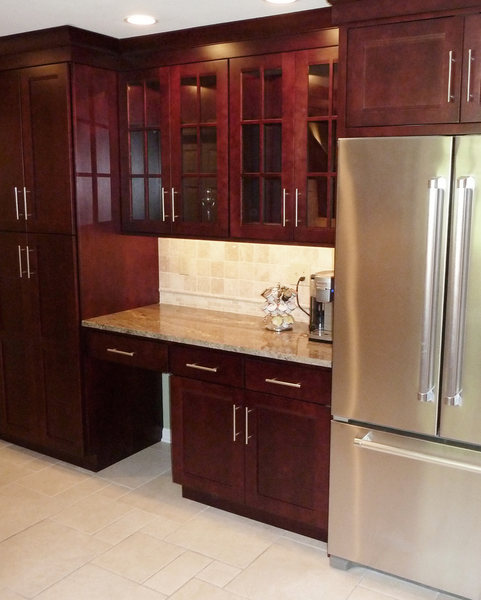 A&E Construction Glass Front Cabinets Stainless Appliances optimized.jpg