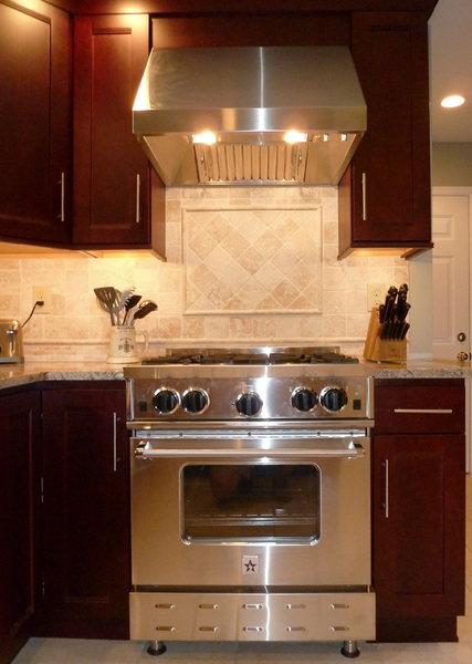 A&E Construction Kitchen Remodel Stainless Stove Hood Tile Inset Backsplash.jpg