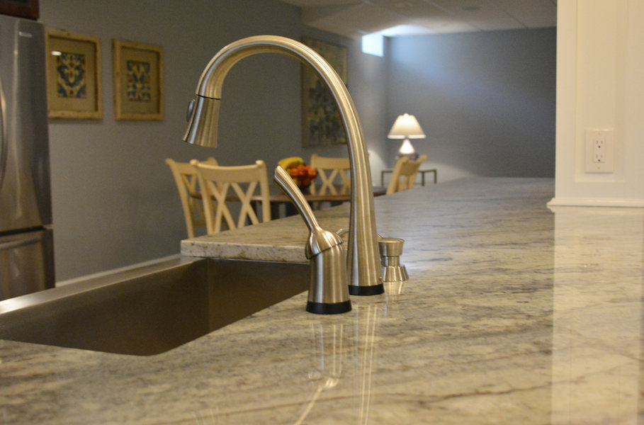 Polished Nickel Faucet Granite Counter Basement Renovation A&E Construction optimized.jpg