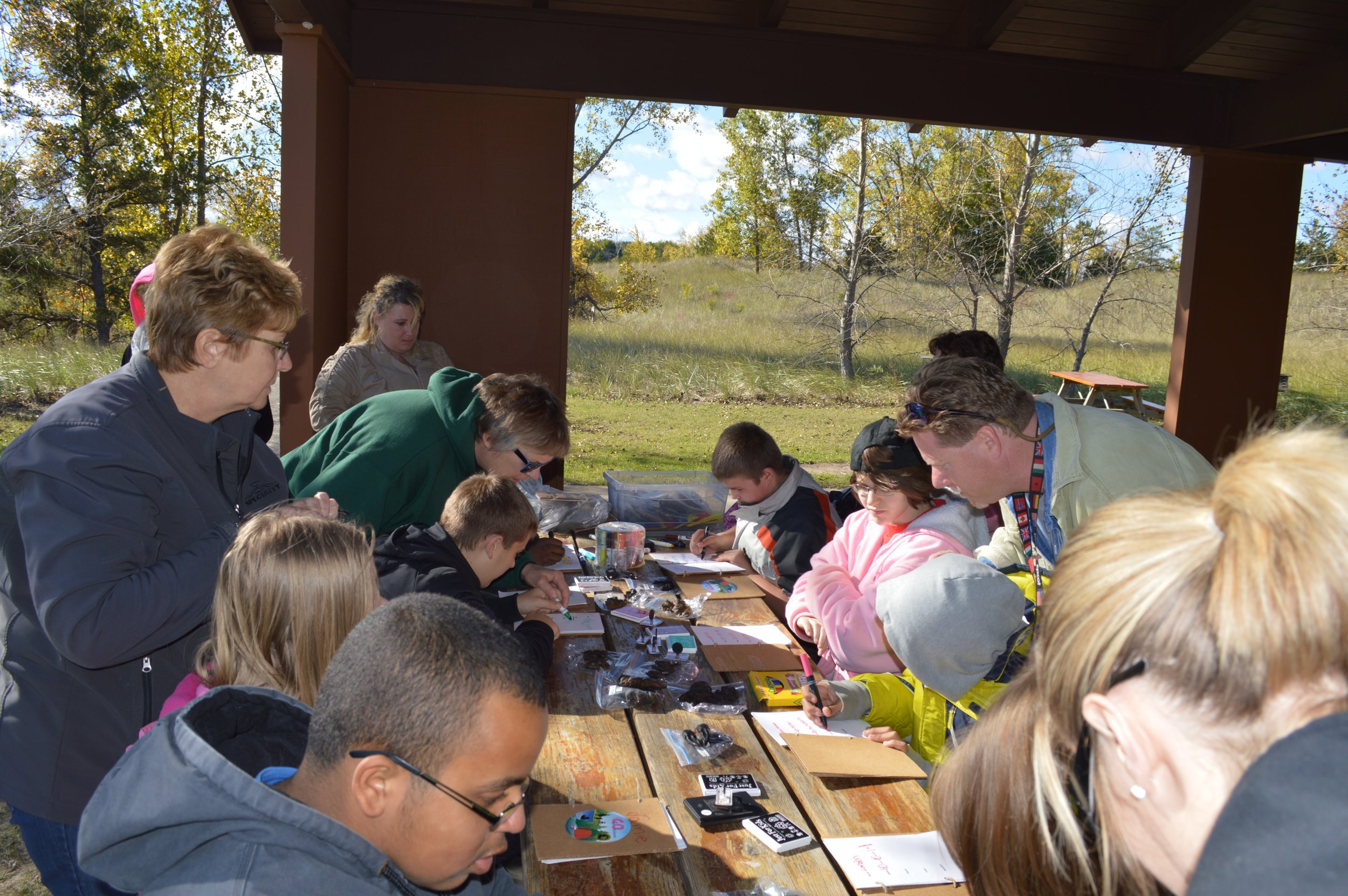 Students from the Huron Learning Center participate in a hands-on learning field trip to the State Park.