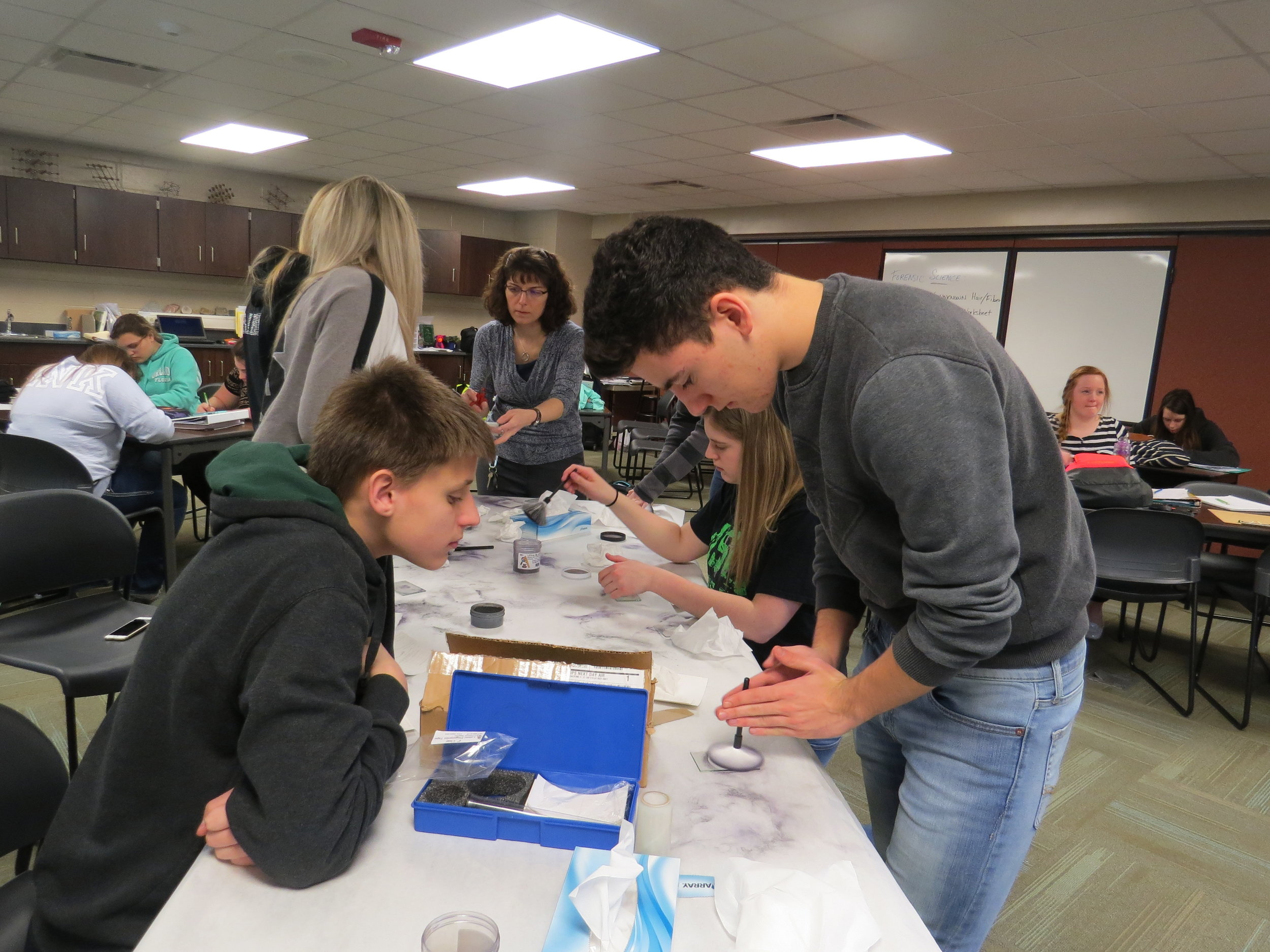 Students learning Forensic Science at  Laker High School