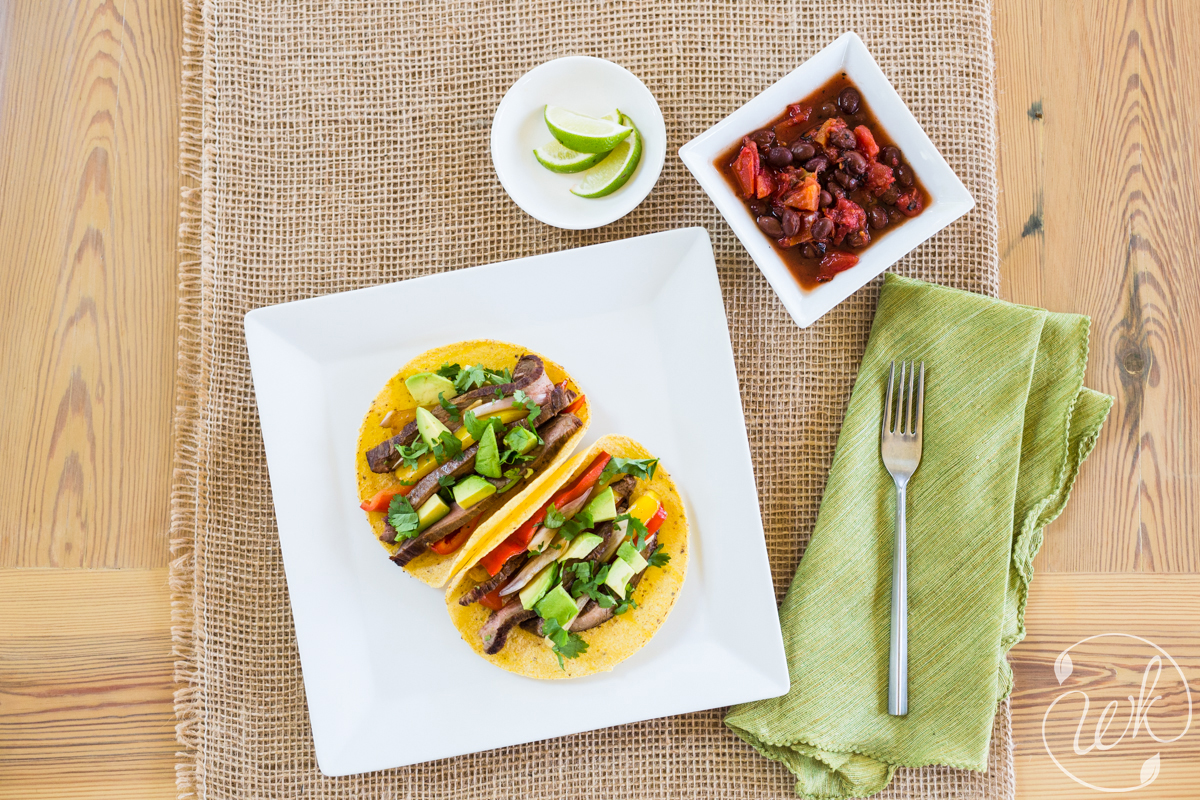 Smoky Grassfed Steak Fajitas with Grilled Bell Peppers, Fresh Avocado. Black Beans with Roasted Tomatoes.