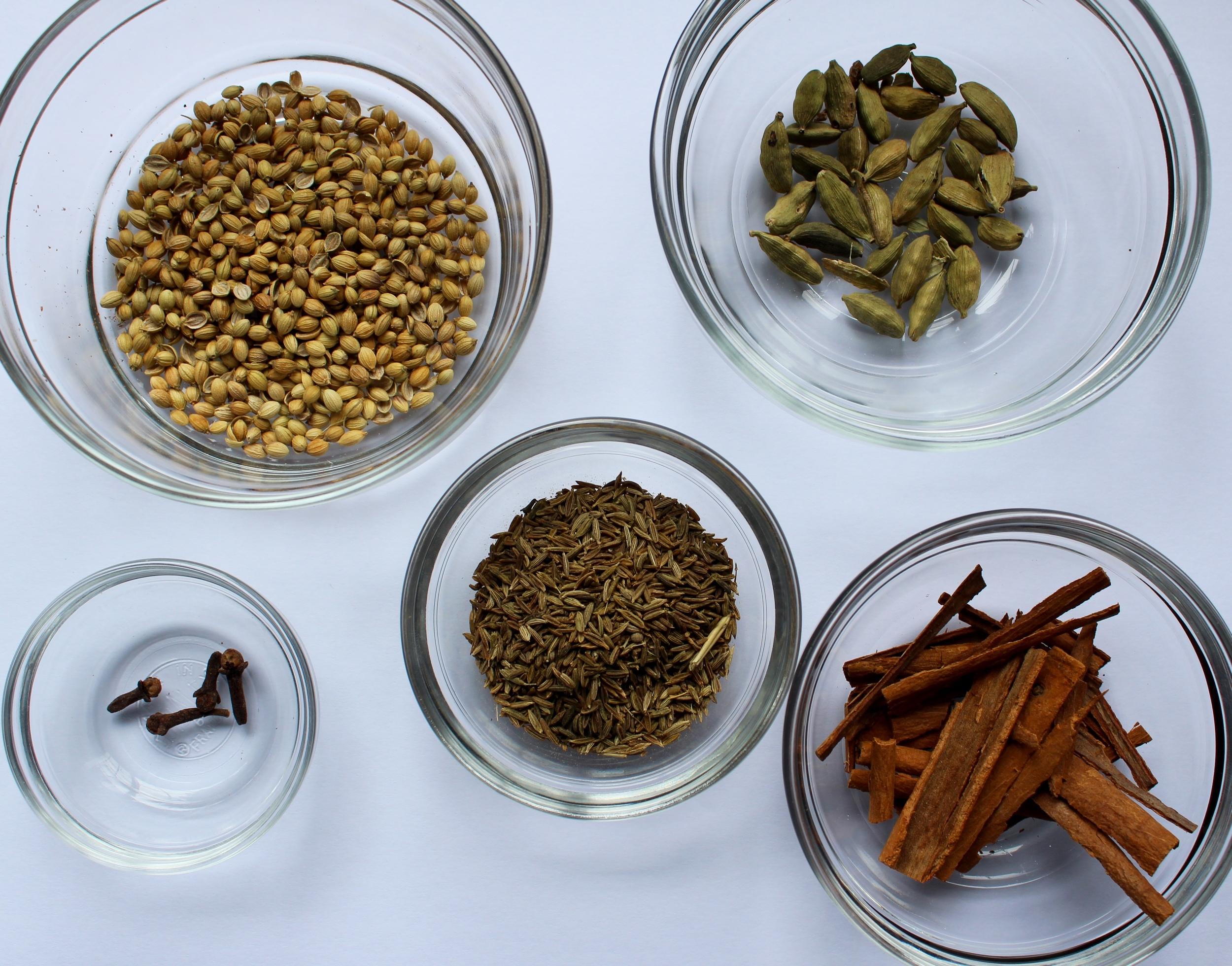 Spices: coriander seeds, cardamom pods, cumin seeds, whole cloves & cinnamon sticks