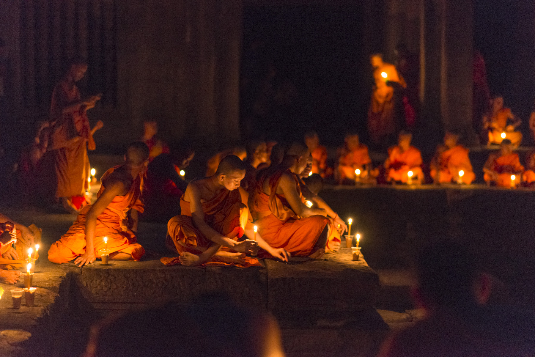Monks getting ready to meditate by the pools of the Gallery of 1,000 Buddhas inside Angkor Wat.