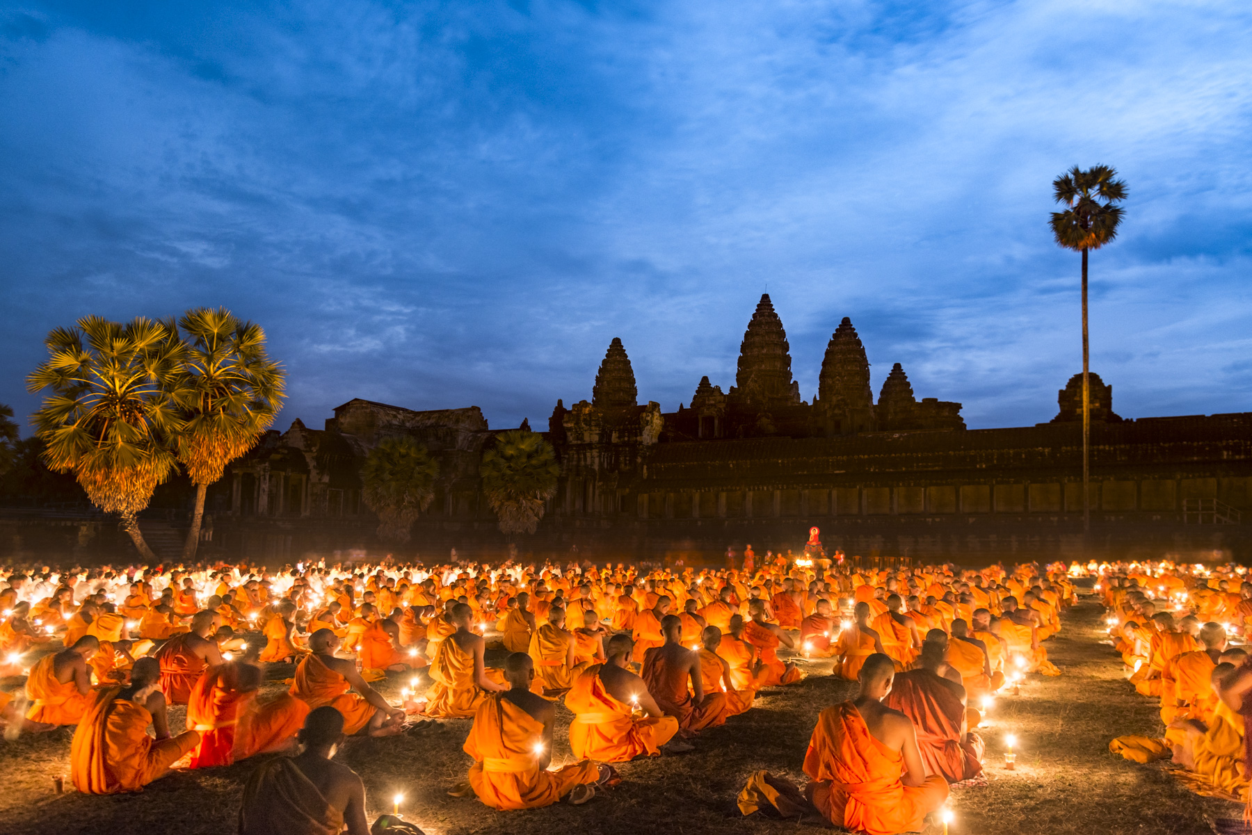 Hundreds of monks and nuns gather under the full moon in front of Angkor Wat for the annual Visak Bochea festival to honour Buddha's enlightenment.