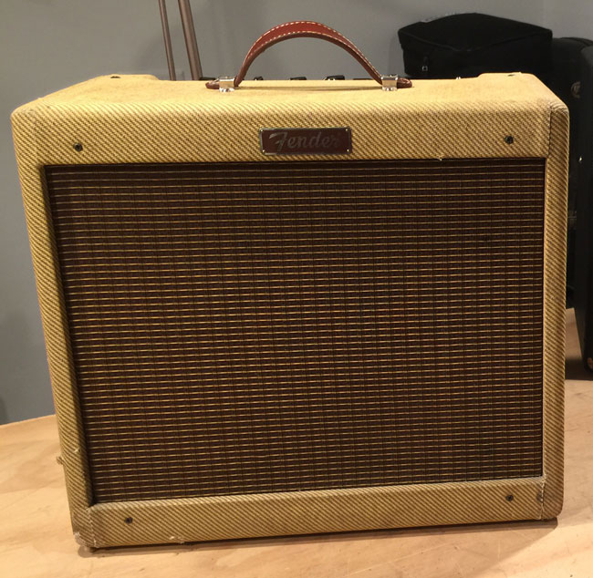 Fender Blues Junior with Tweed covering and new leather handle.  It was made in 1995 and is a Rev-B board, one of the earliest Blues Juniors.