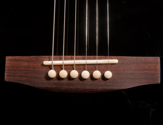 Here is a the new compensated saddle cut to the specific guitar strings and set-up the player was looking for.