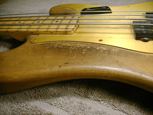 Figure 1  - 1958 Fender Precision bass with the finish stripped off by the owner. Once he realized how hard the job was he quit, leaving the wood exposed to the elements and also ruined the value.