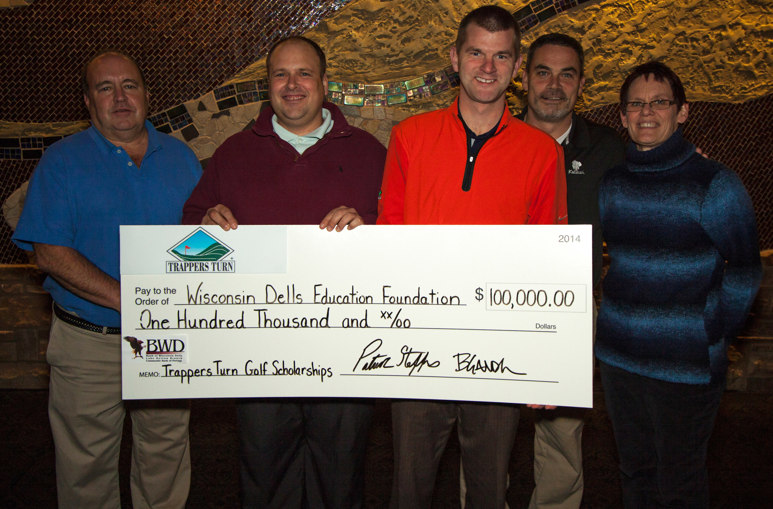 Representing Trappers Turn Golf Club in Wisconsin Dells are Patrick Steffes and Bob Gander presenting a $100,000 check to the Wisconsin Dells Education Foundation. This donation will establish endowment funds for the Girls and Boys Golf Scholarships at Wisconsin Dells High School. A $2,000 scholarship will be award each year to a senior girl and boy on the golf teams. Accepting the donation for the Foundation are board members: Joe Gussel, Todd Nelson, and Marti Fults.